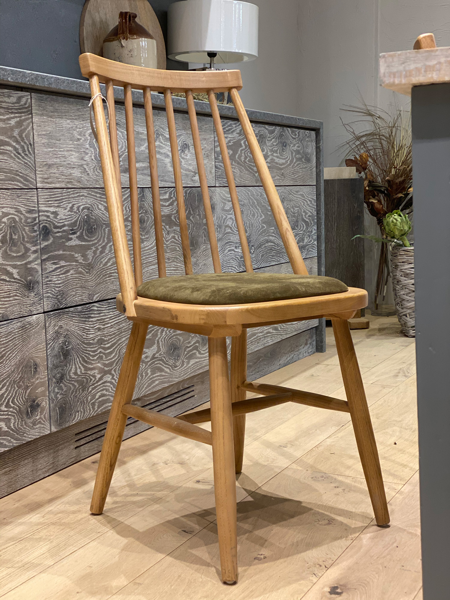 Oak chair with green felt seat