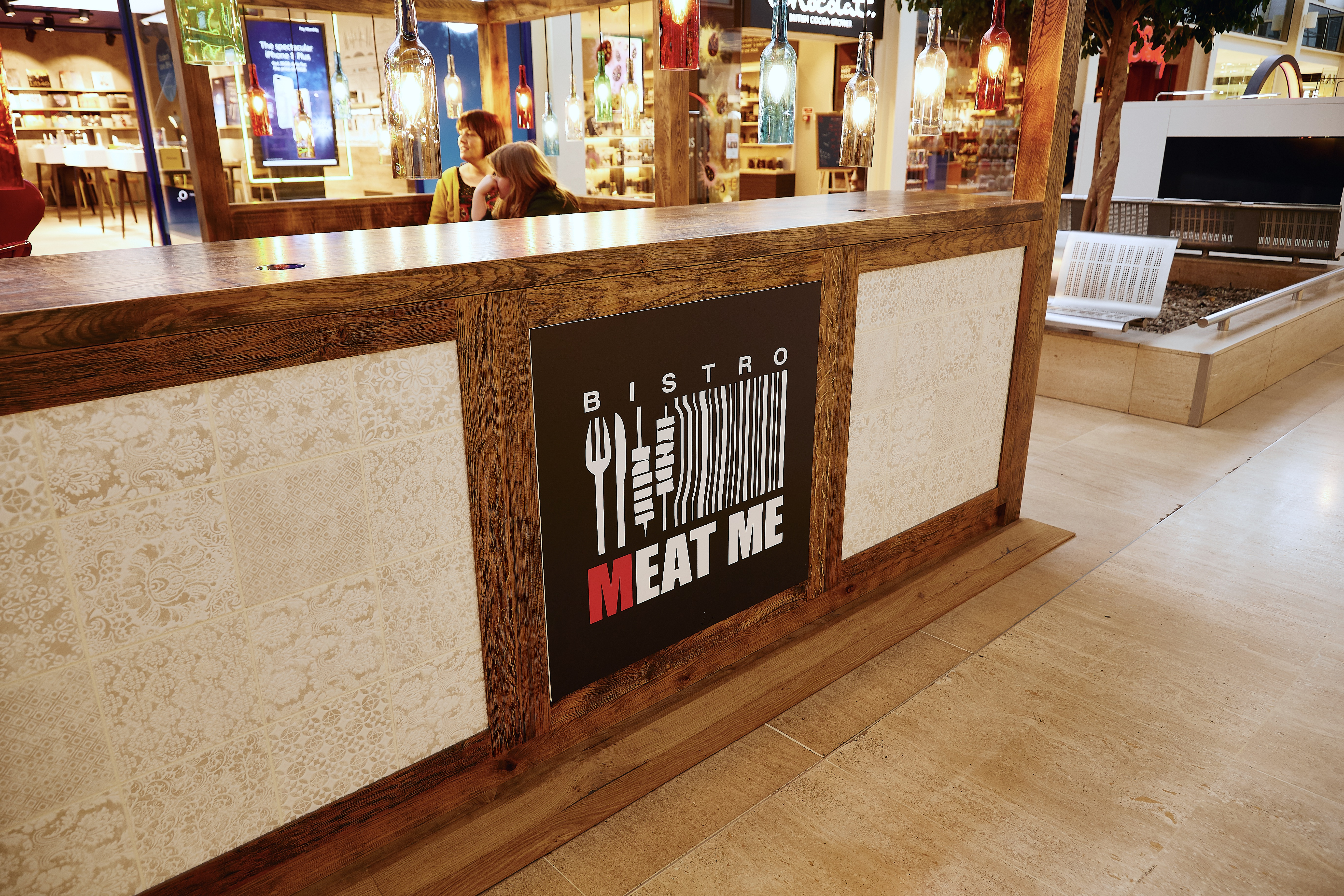 Branding board of Meat Me Bistro with tile and rustic wood surround