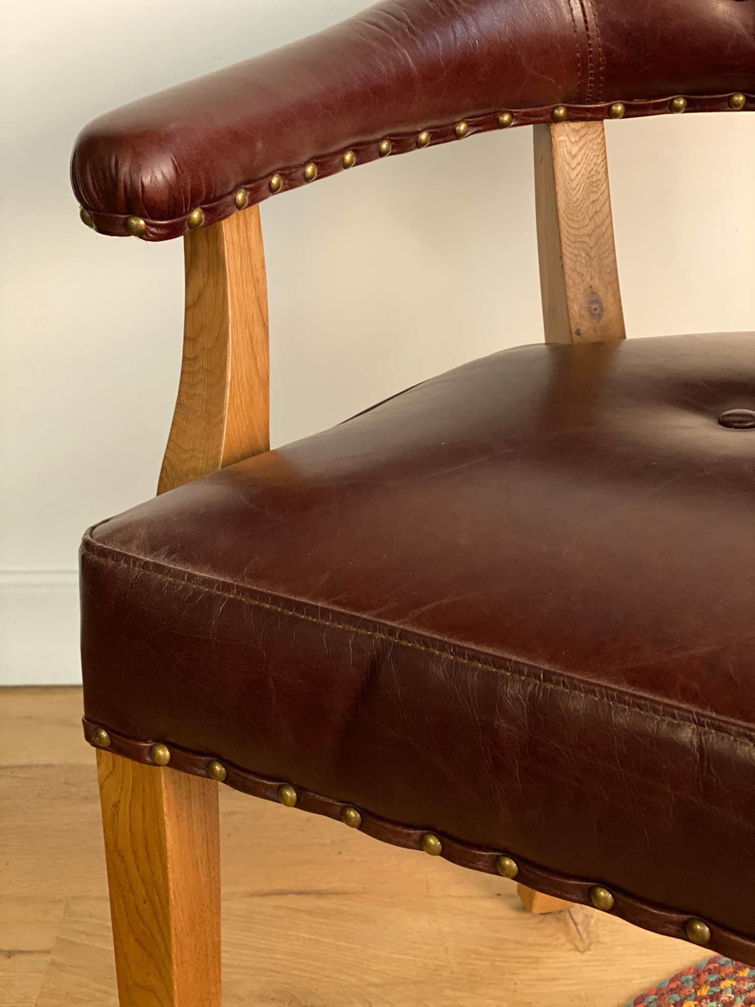 Leather office chair arm detail with brass studs