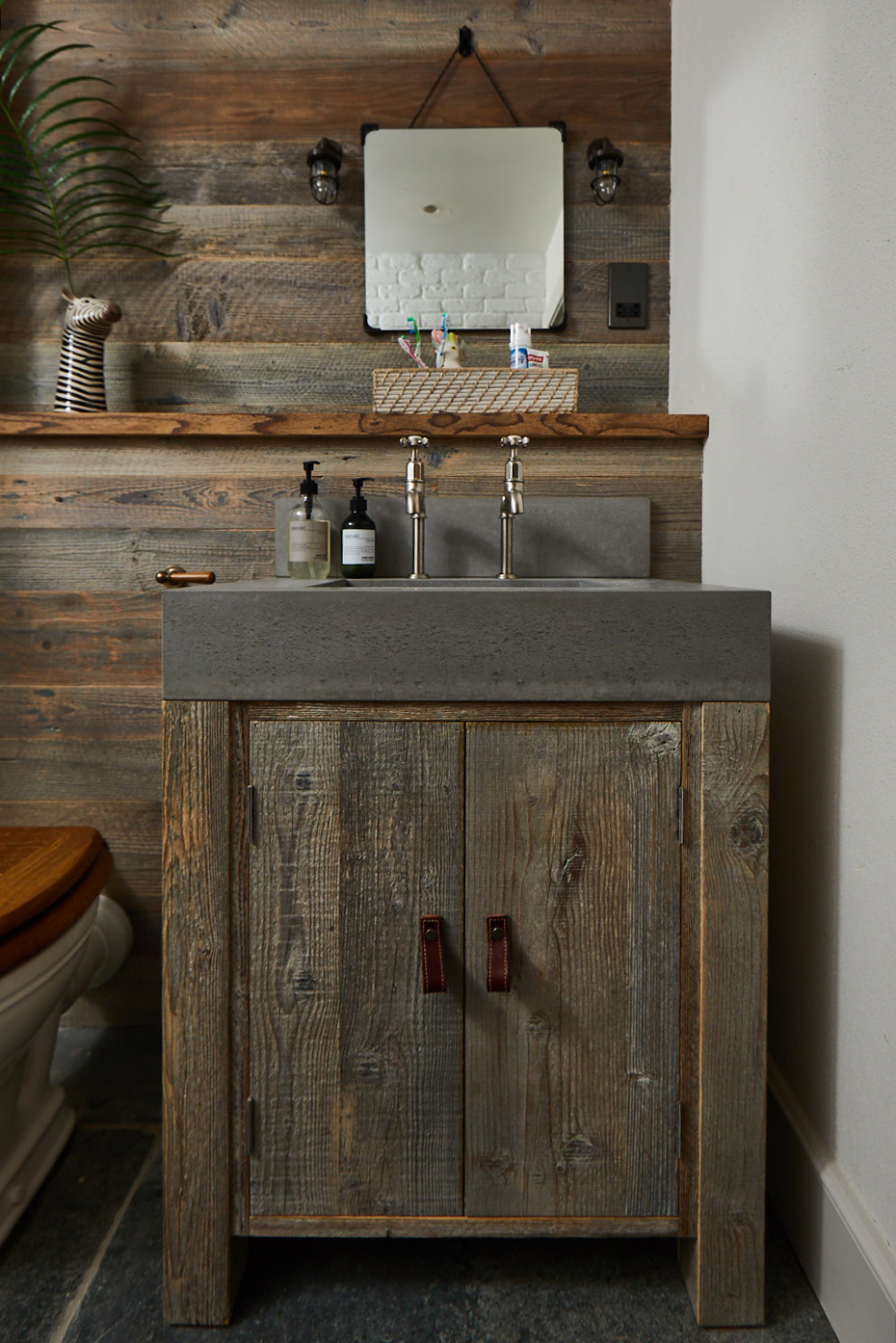 Reclaimed pine vanity unit with solid grey concrete sink