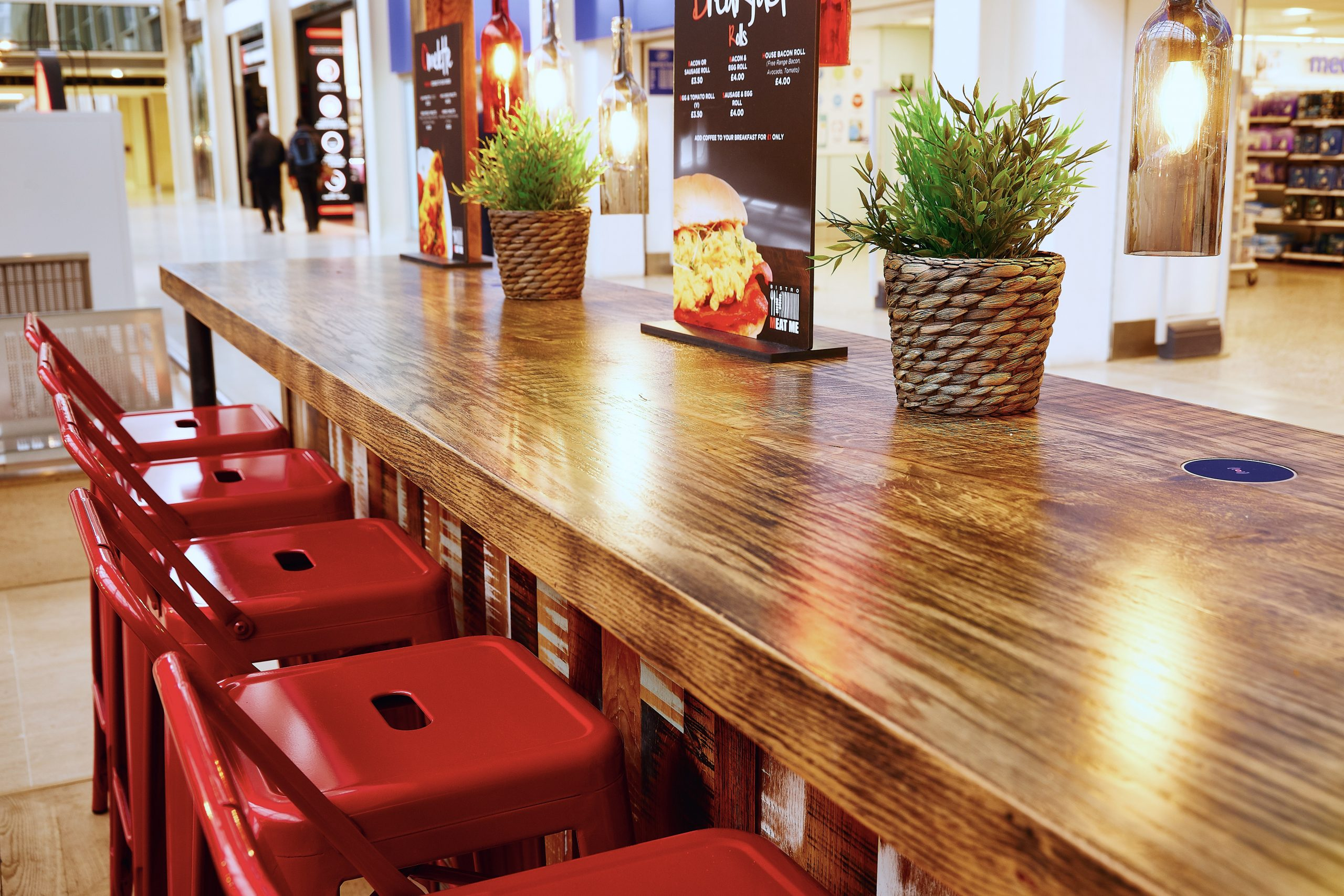 Rustic bar seating with red industrial stools