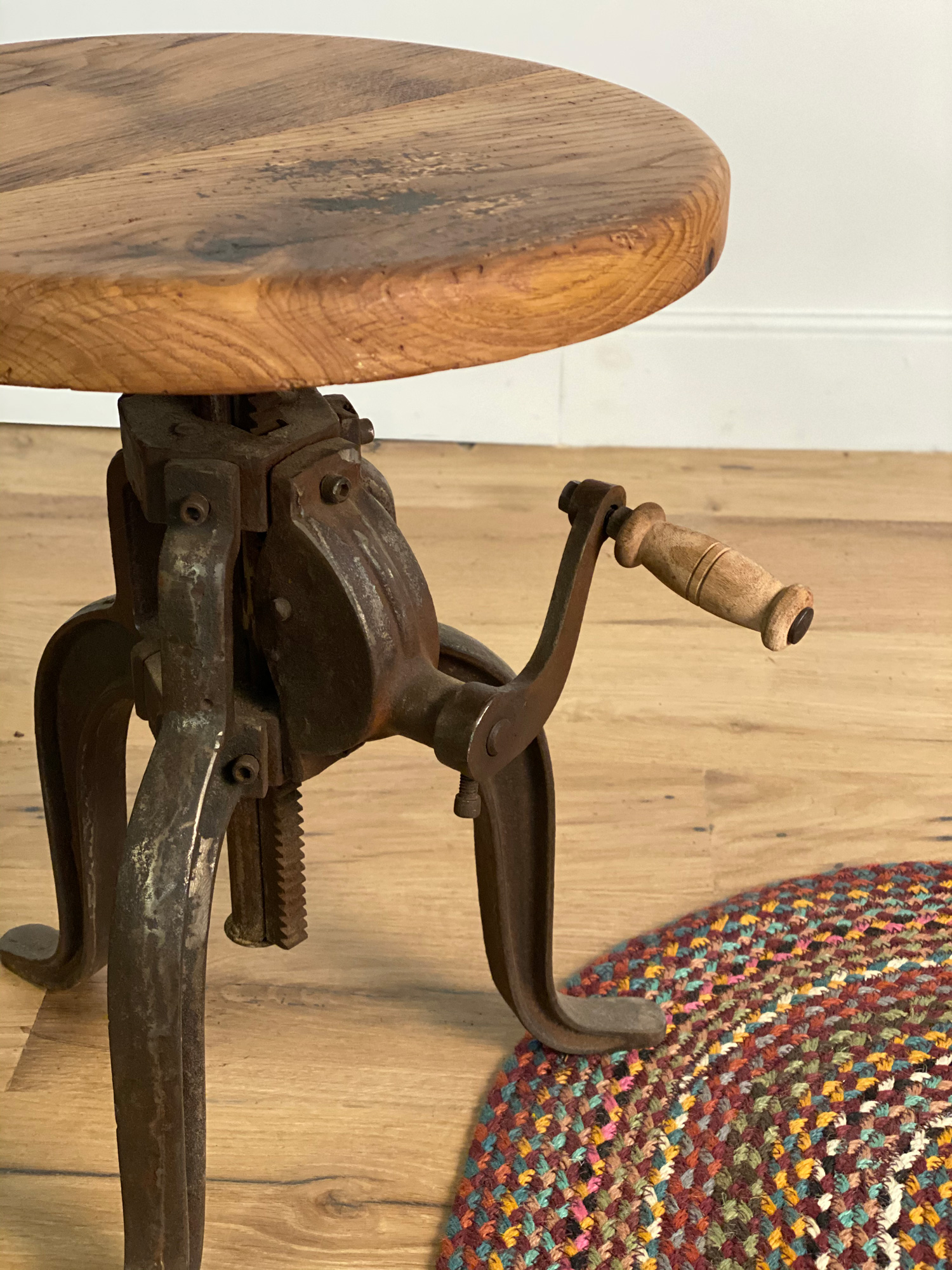 Industrial side table made from cast iron and solid oak