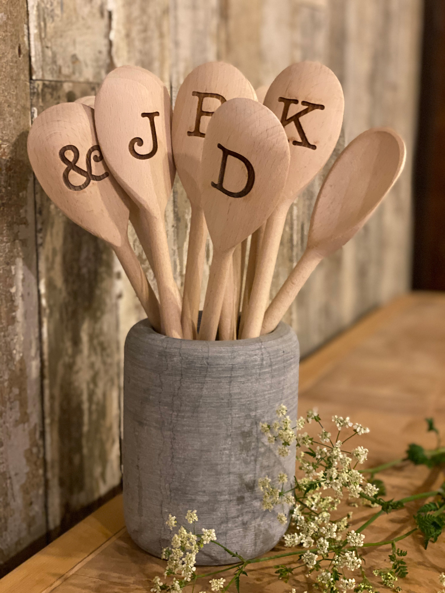 Wooden spoons with alphabet letters in concrete holder