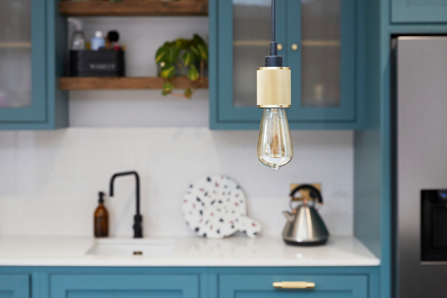 Buster and Punch heavy metal pendant light bulb above bespoke kitchen