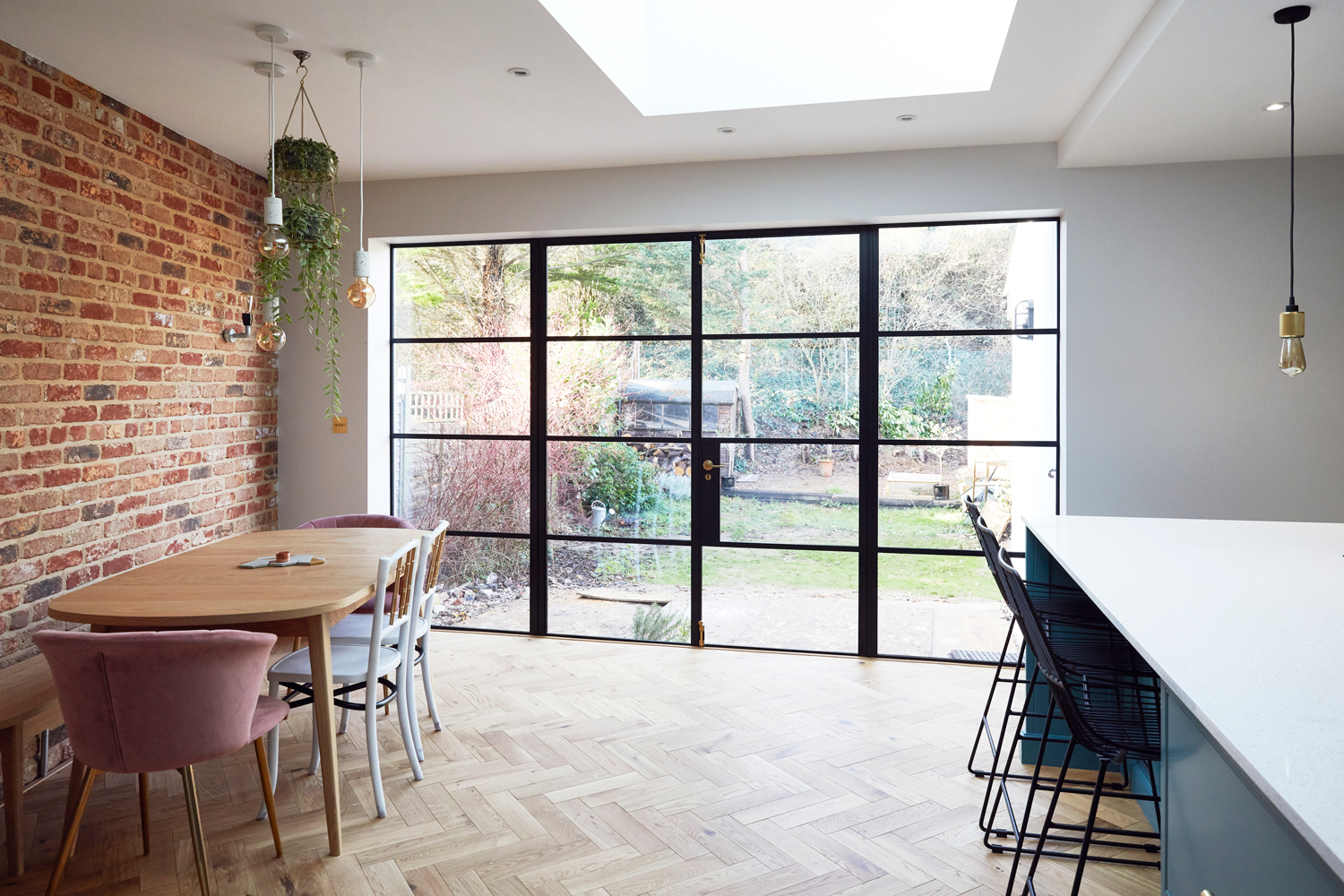 Crittall style patio doors with parquet oak flooring