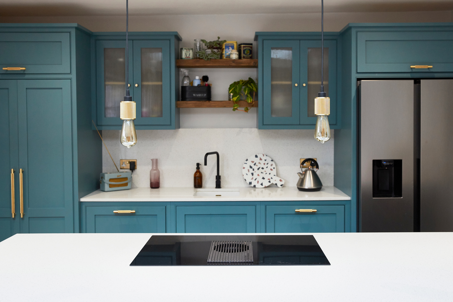 Kitchen painted in Tea With Florence by Little Greene with Buster + Punch lights above