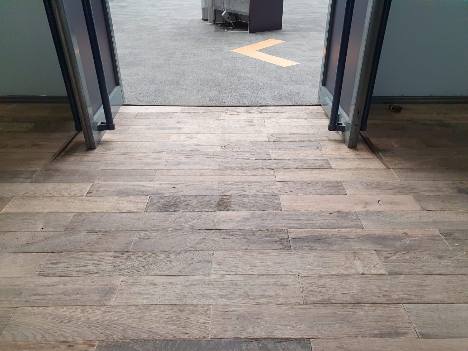 Reclaimed engineered flooring blocks laid on the showroom floor with integrated disabled ramp