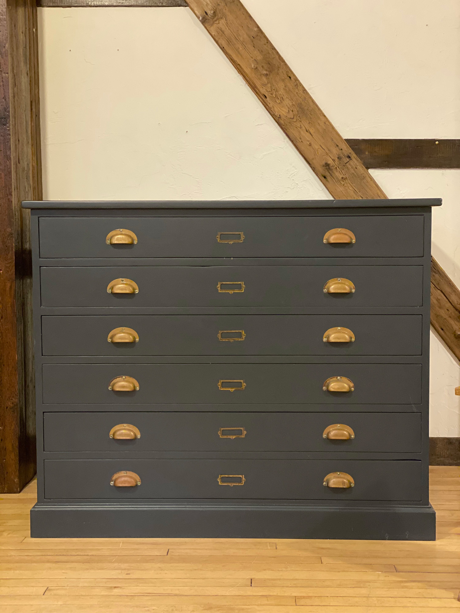 Original plan chest painted in blue with burnt brass cup handles