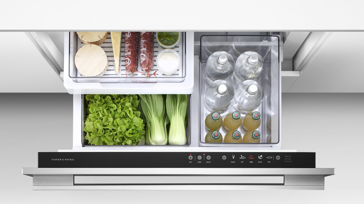 Fisher Paykel CoolDrawer open with fresh vegetables and drinks