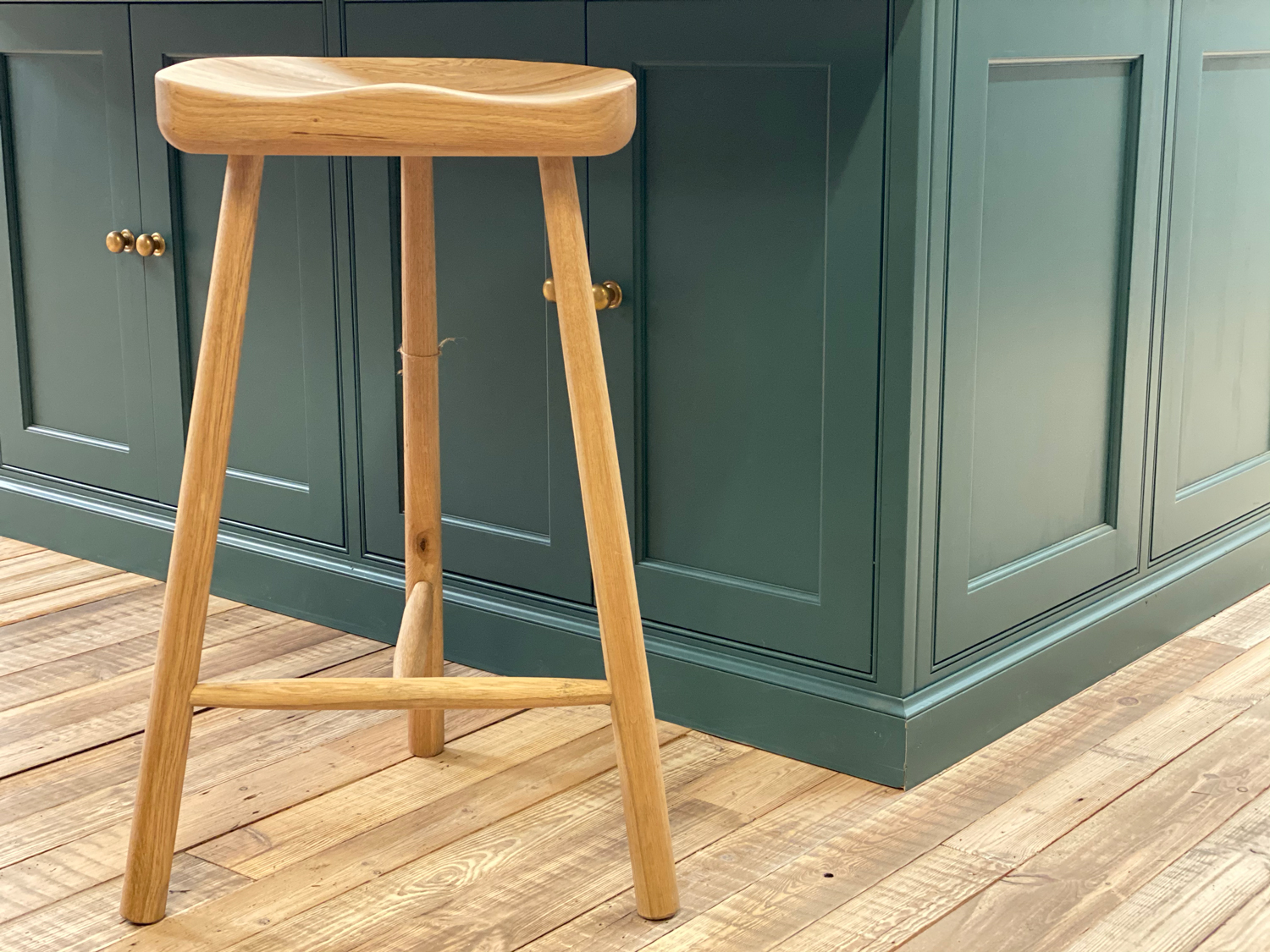 Clean oak three legged bar stool