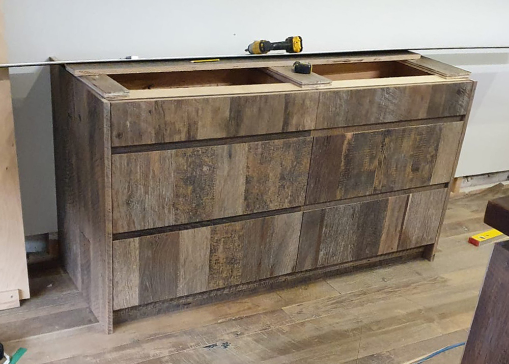 Reclaimed engineered pan drawers being installed in to London showroom