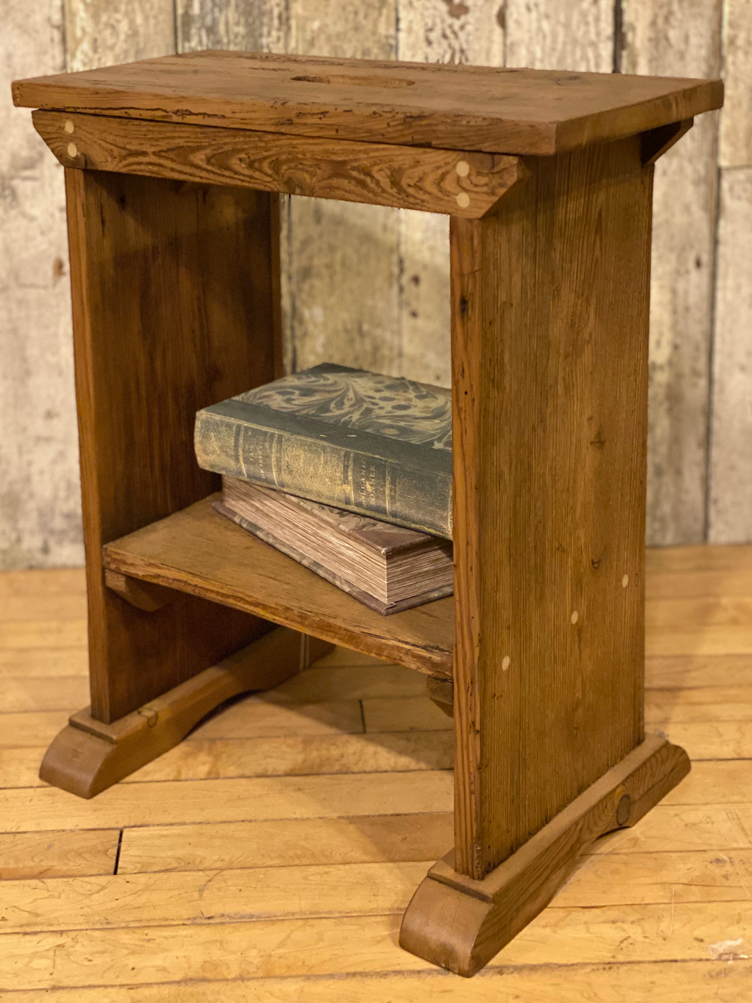 Reclaimed pine stool with books on base