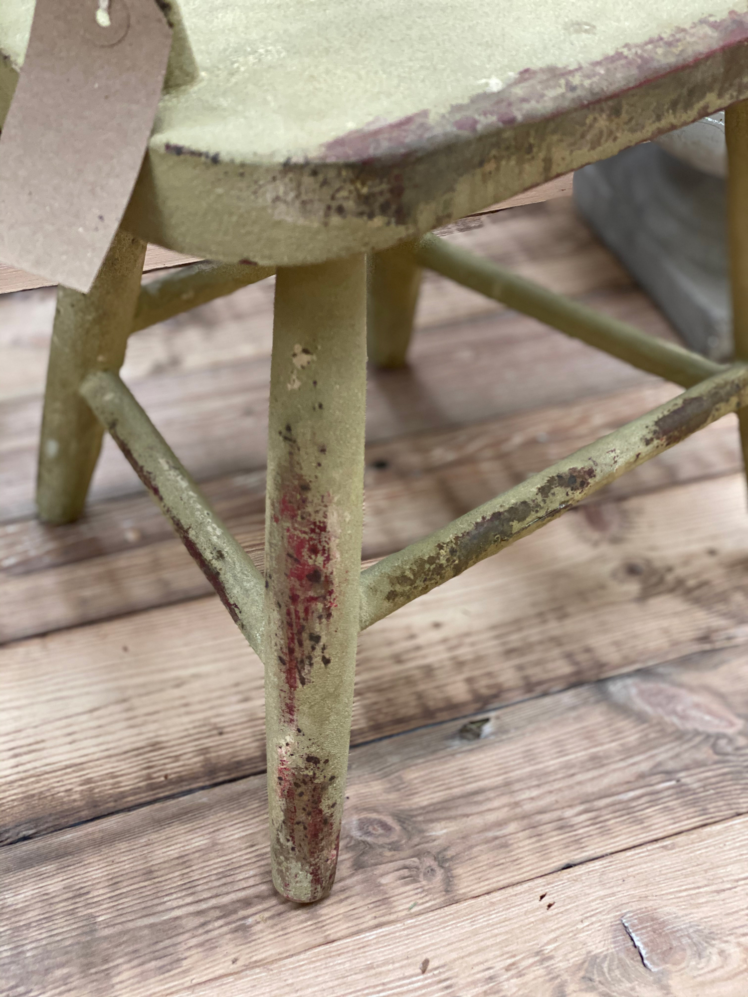 Rustic green toddlers chair with curved back