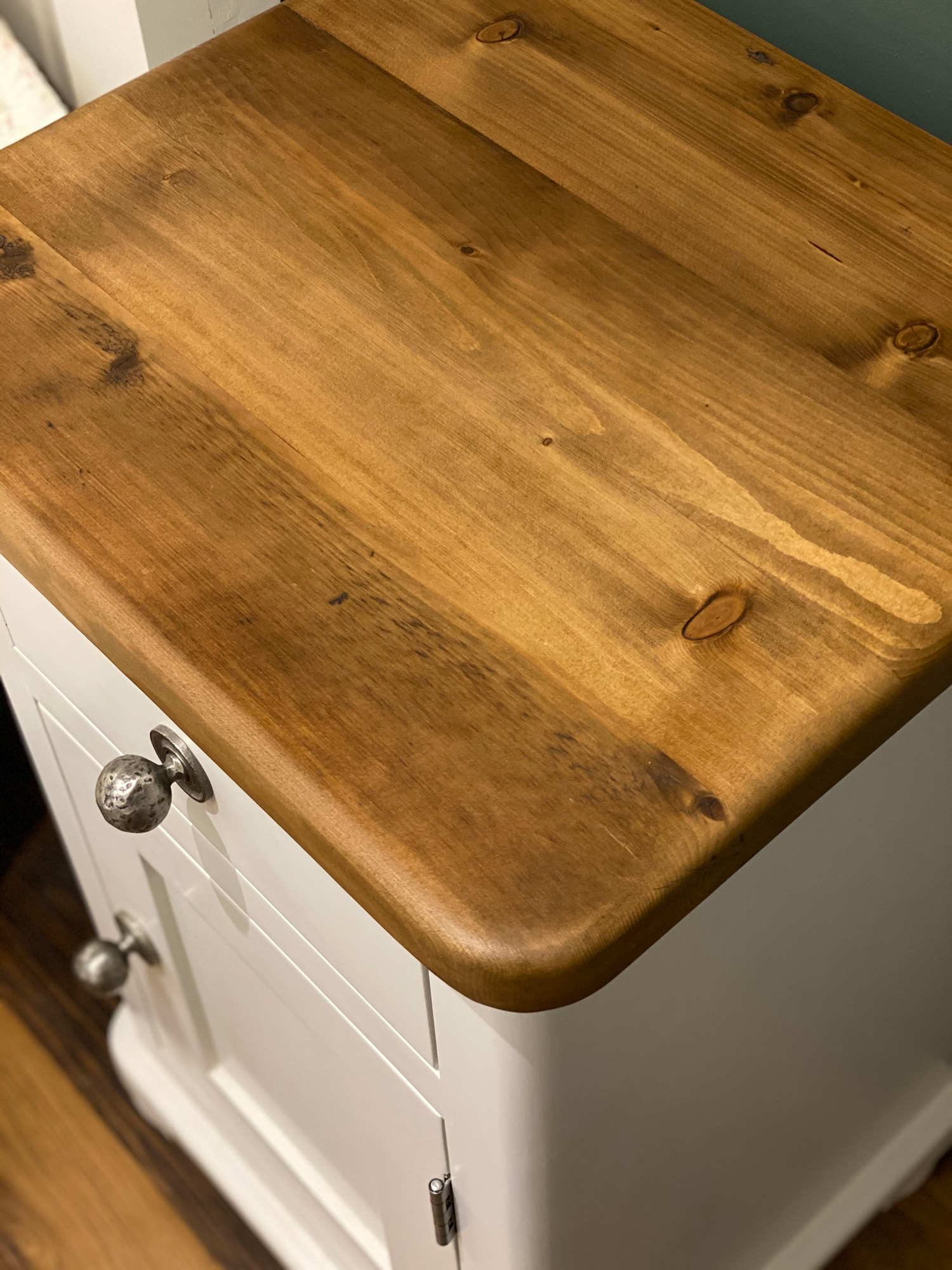 Reclaimed waxed pine worktop on painted bedside table