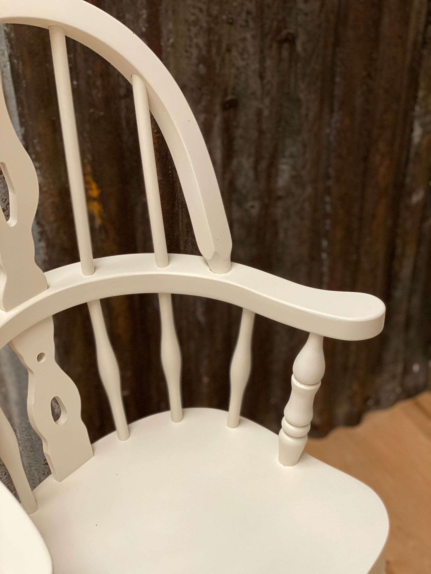 arm detail on white painted childs windsor chair