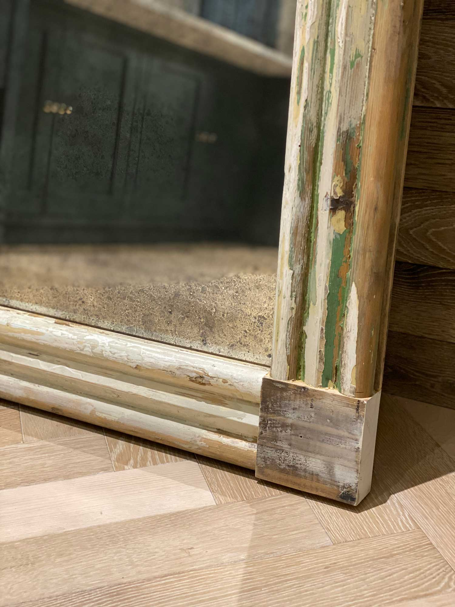 Rustic and reclaimed frame around vintage mirror