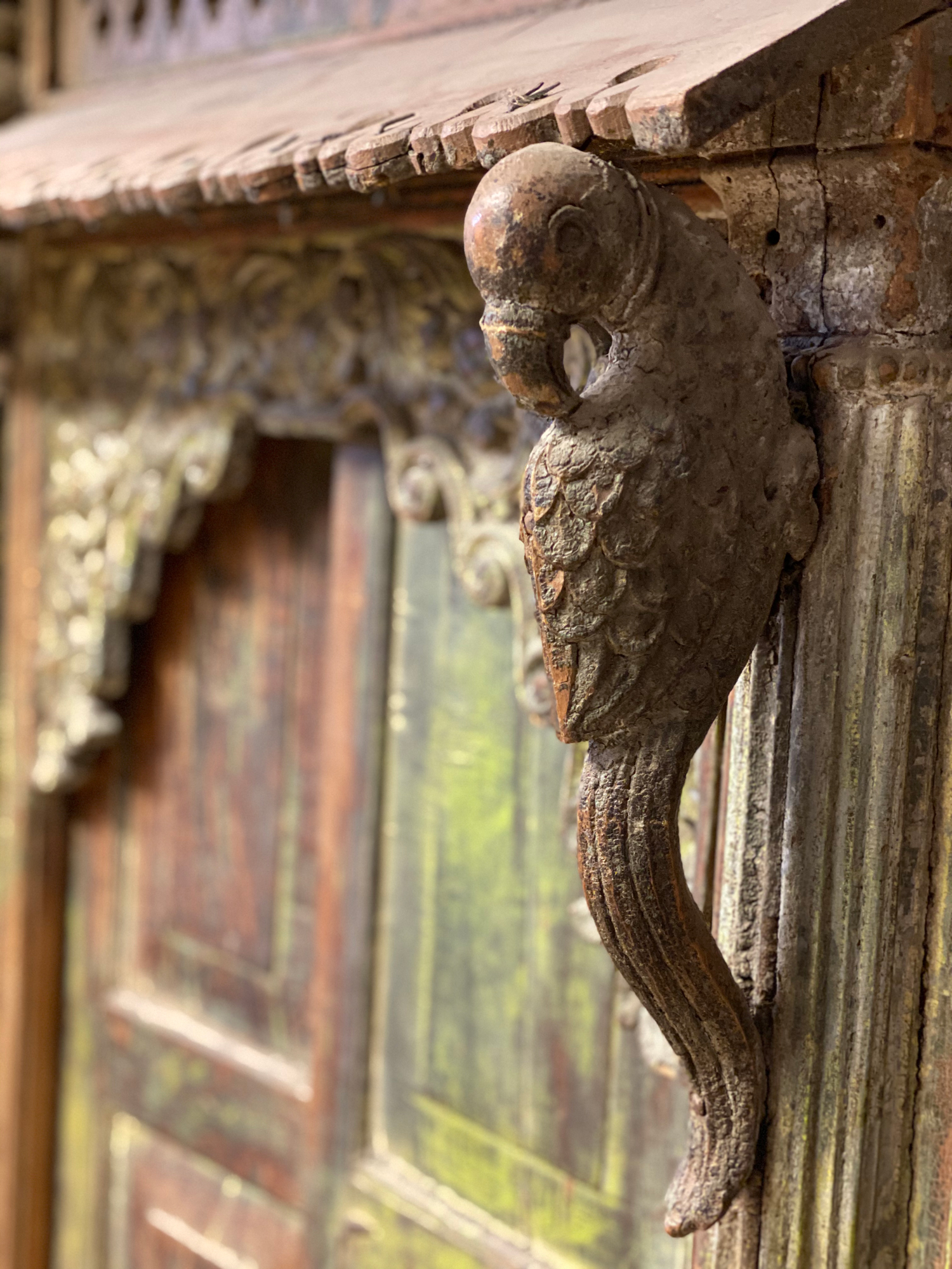 Carved parrot on original antique room divide