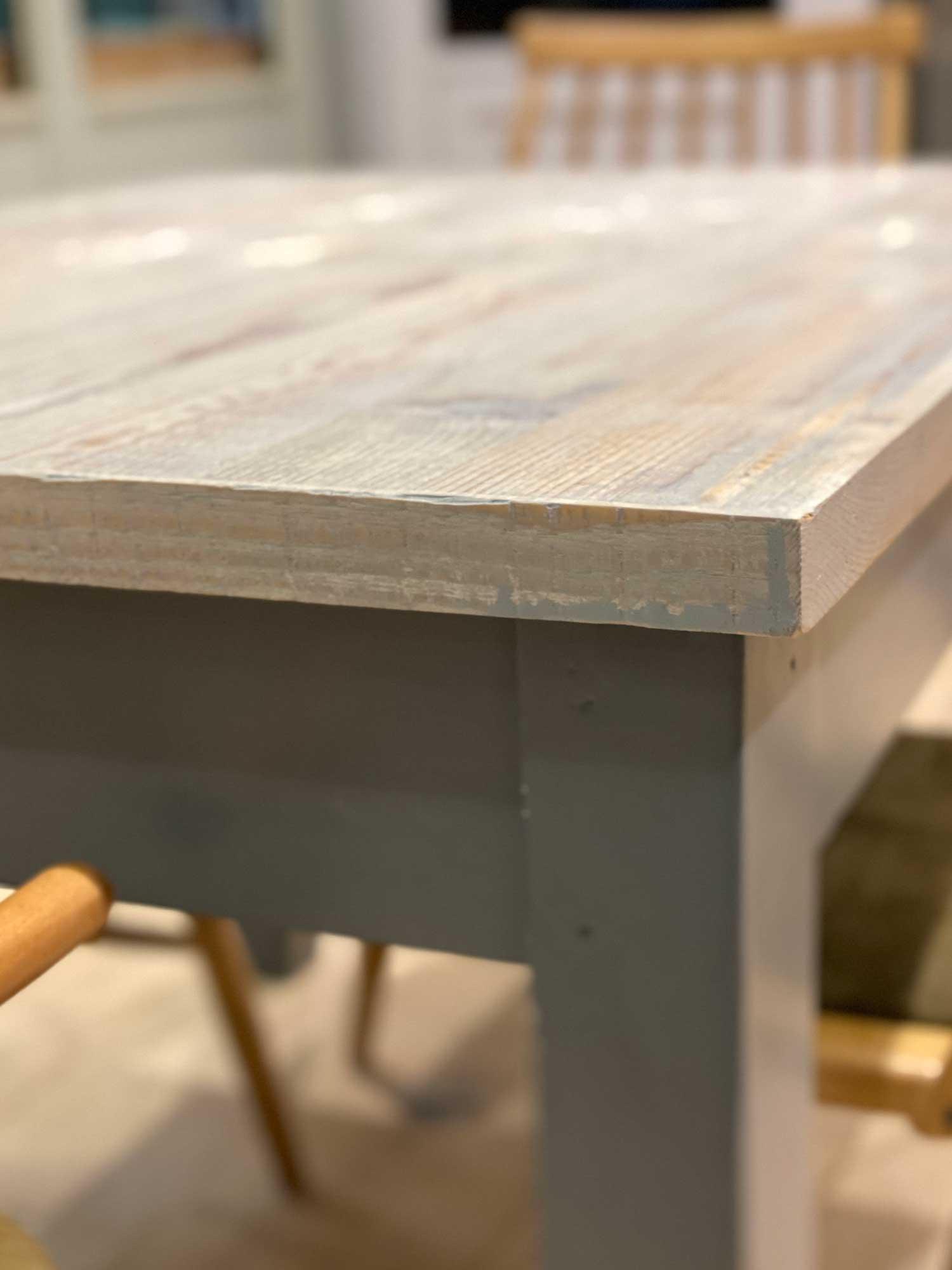Corner detail on whitewash engineered table