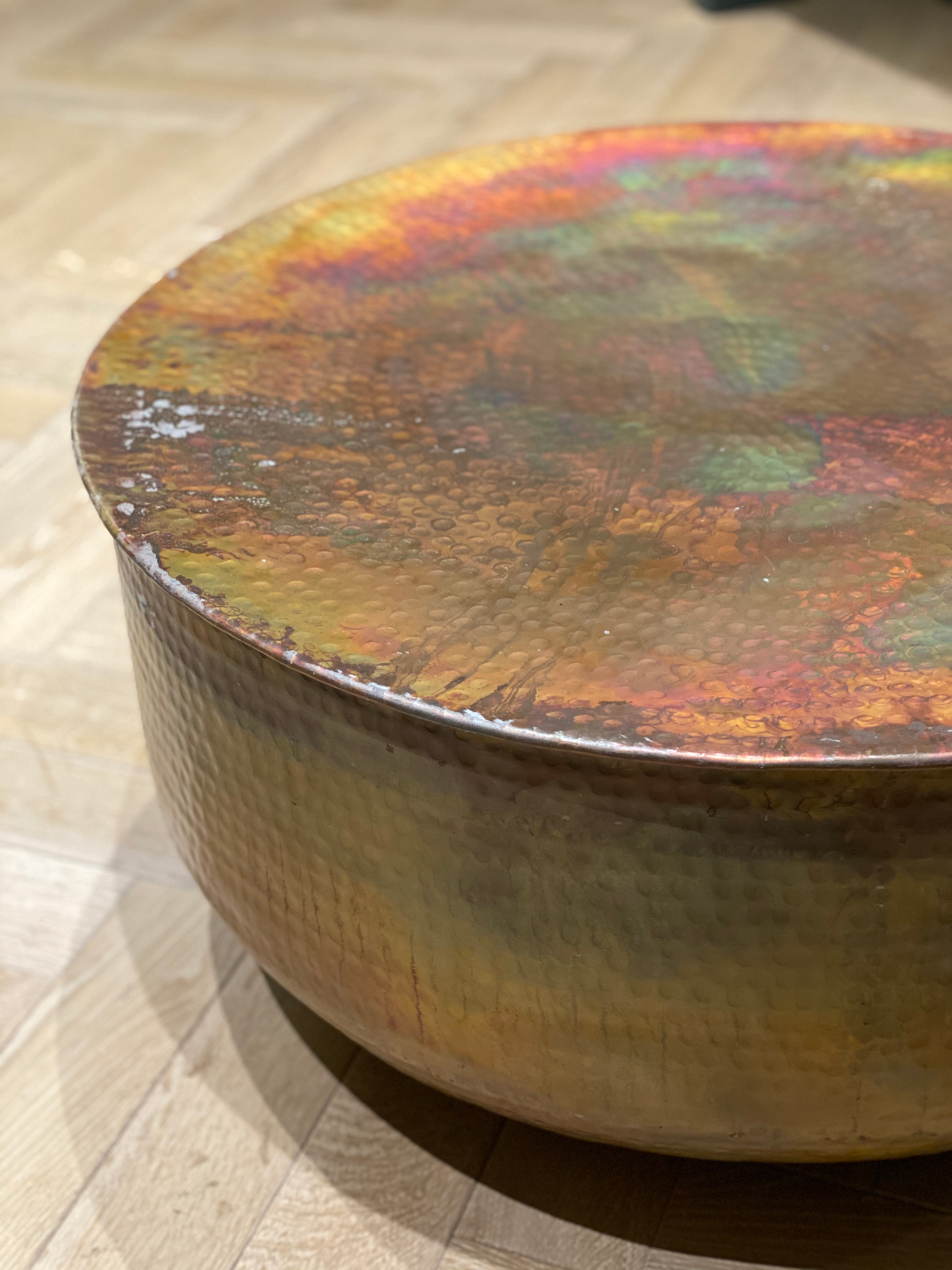 Edge detail of hammered copper round table