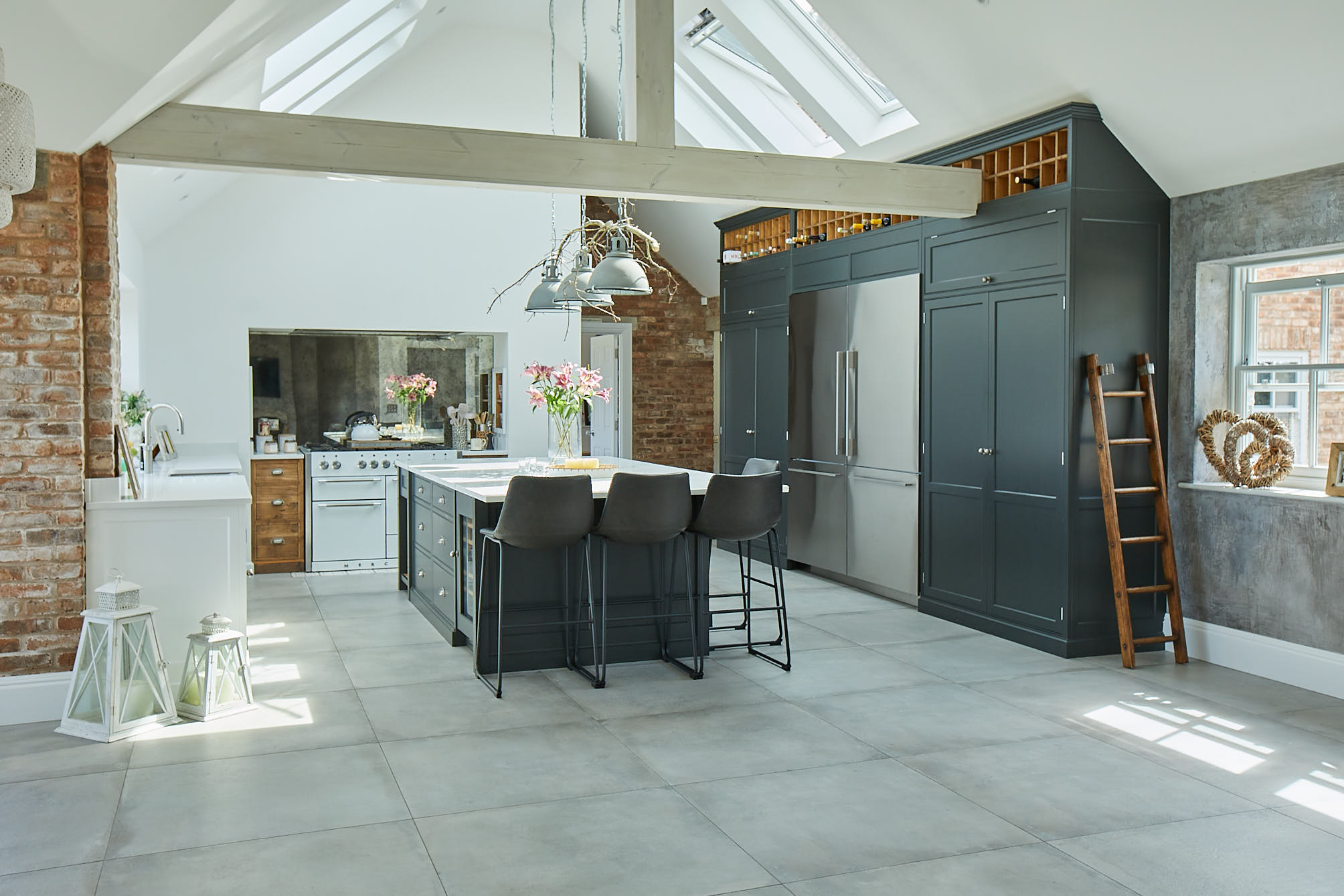 Bespoke kitchen with tall black cabinets and white range cooker