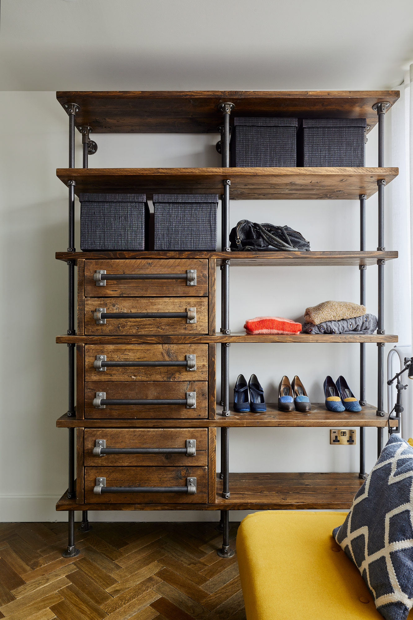 Reclaimed pine drawers with iron pipe hardware and parquet oak flooring