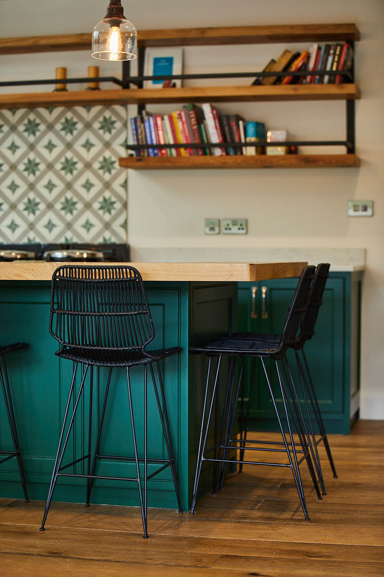 Black metal barstool with green bespoke kitchen island