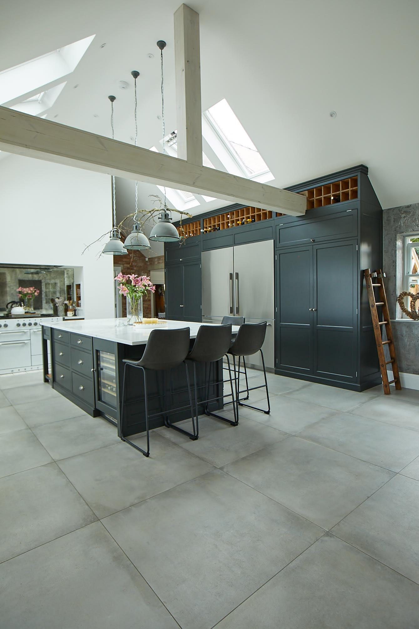Black painted bespoke island and tall kitchen units