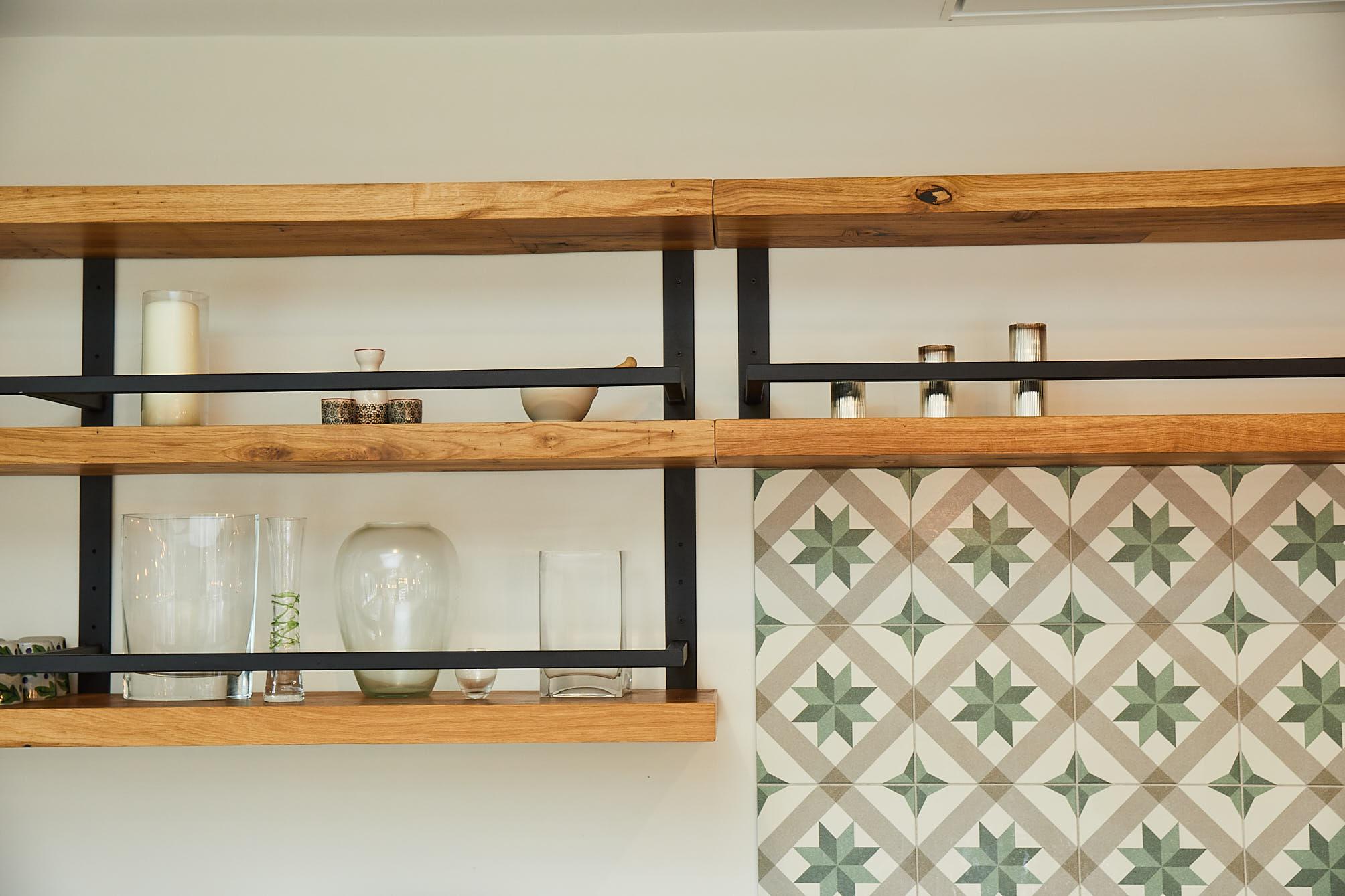 Floating chunky oak shelves with black powder coated frames