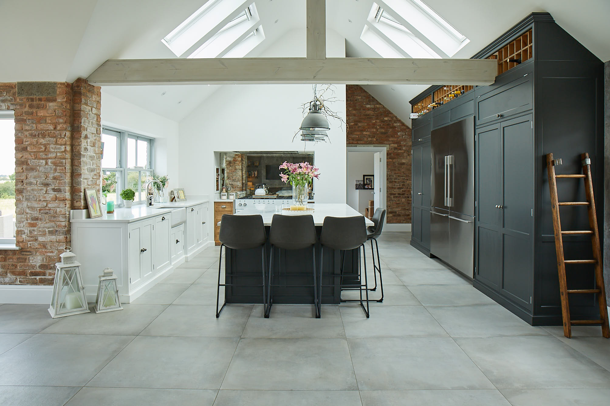 Lamp black kitchen units with leather barstools