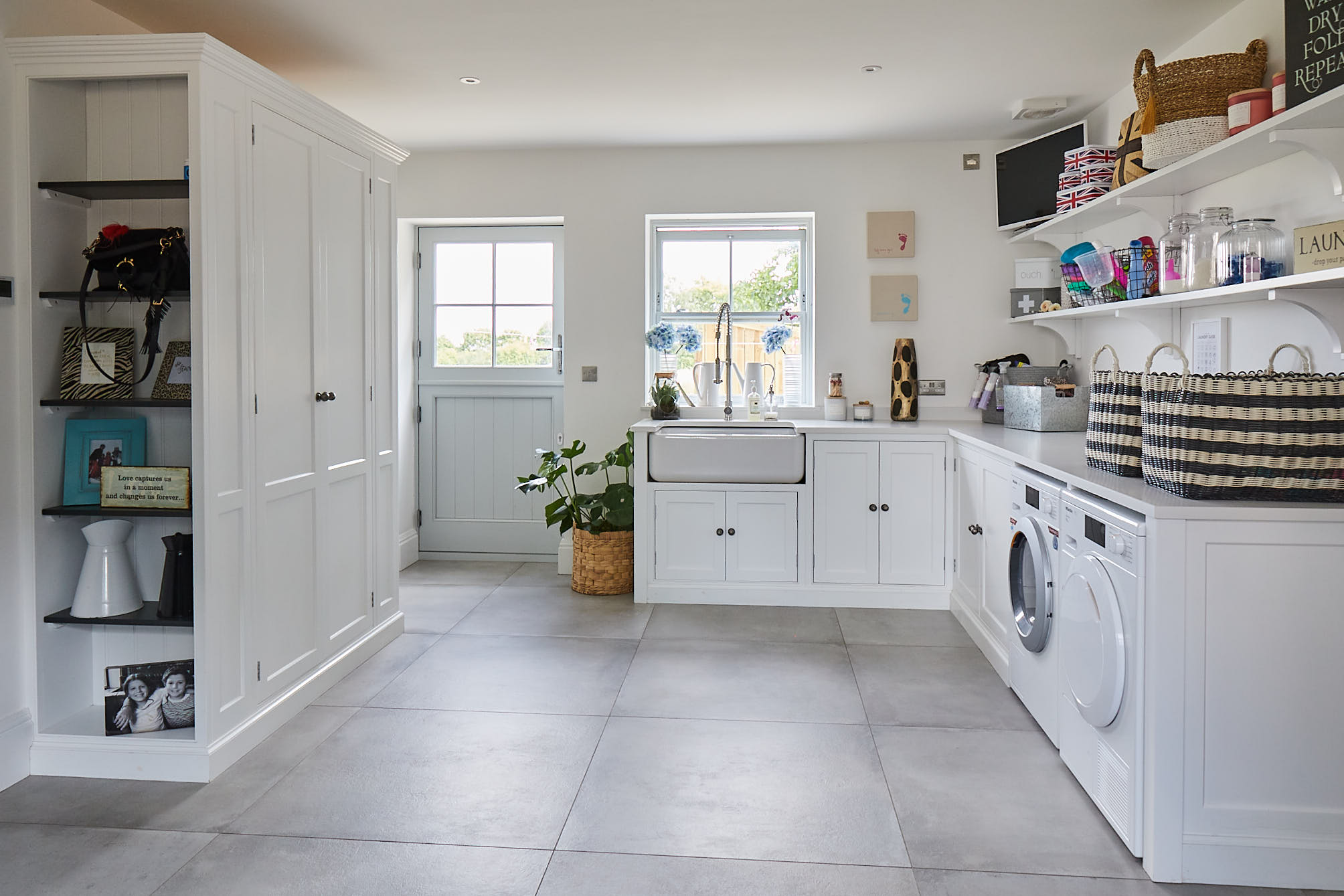 Bright white utility with large square porcelain tiles
