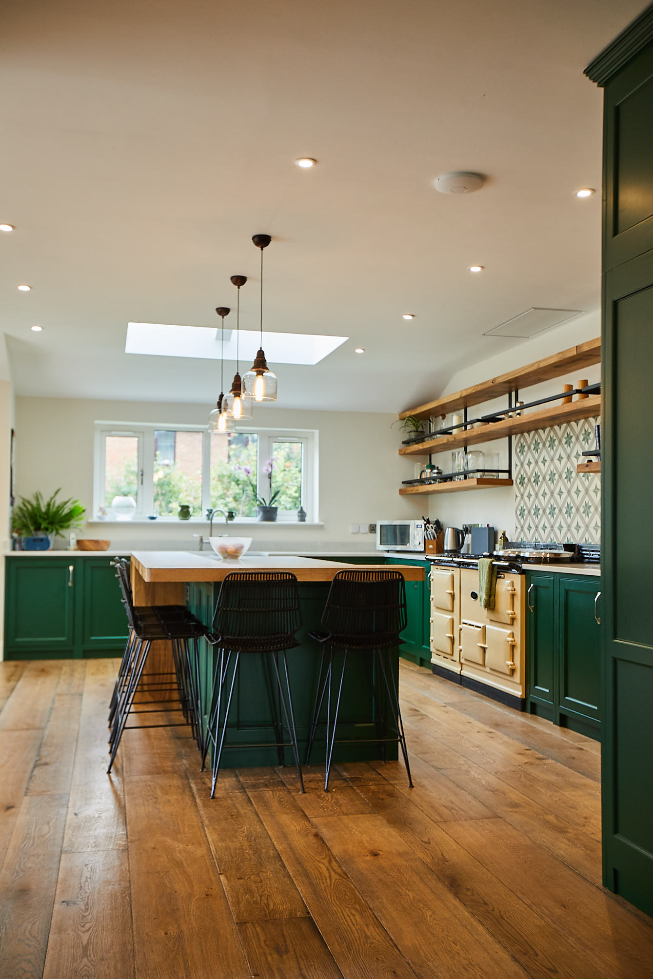 Puck green bespoke kitchen with cream AGA and island