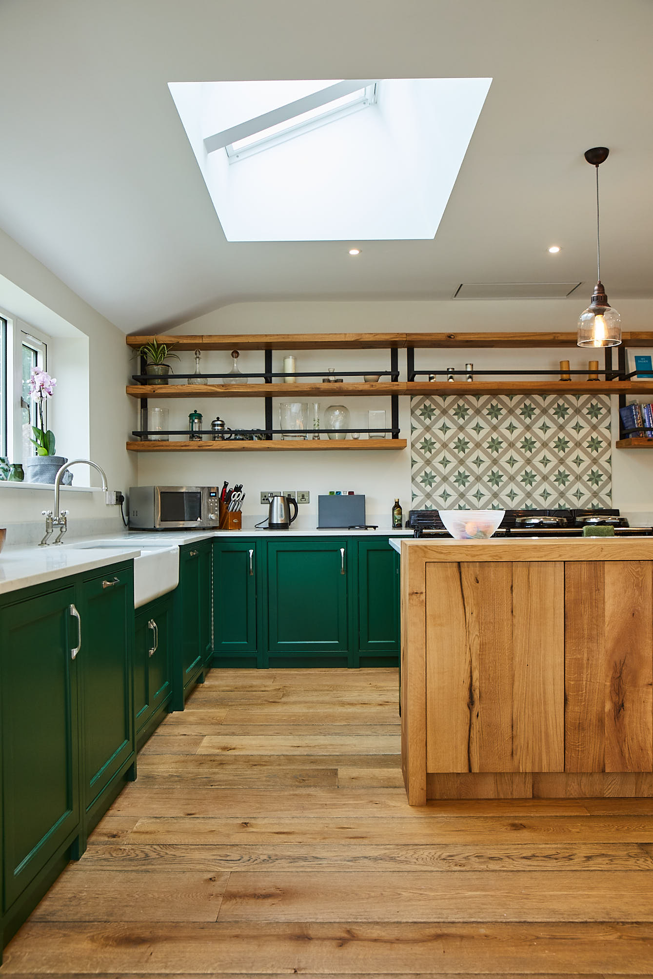 Puck Little Greene kitchen cabinets with oak open shelves and Belfast ceramic sink