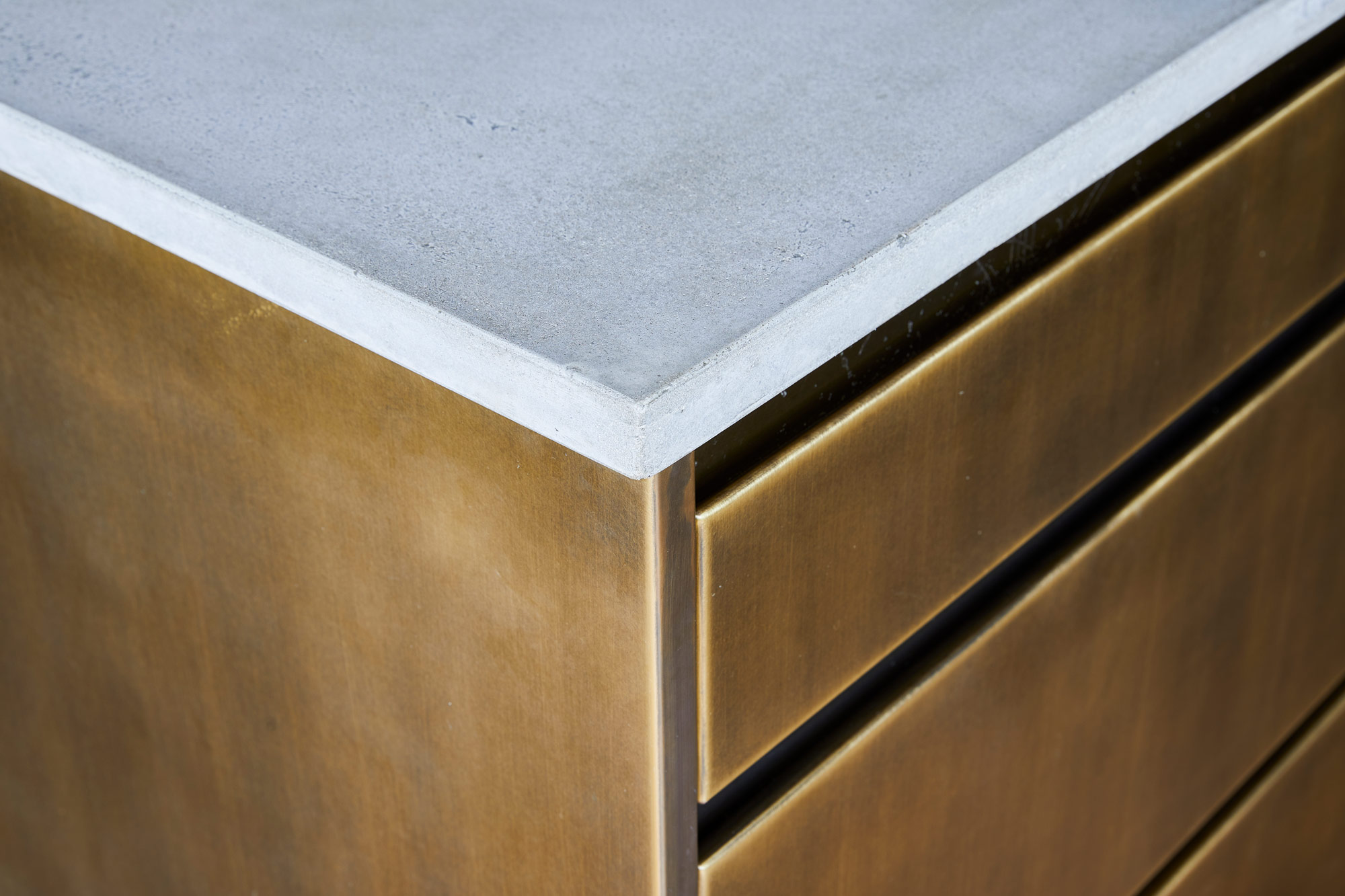Solid concrete worktop on top of bespoke metal kitchen drawers
