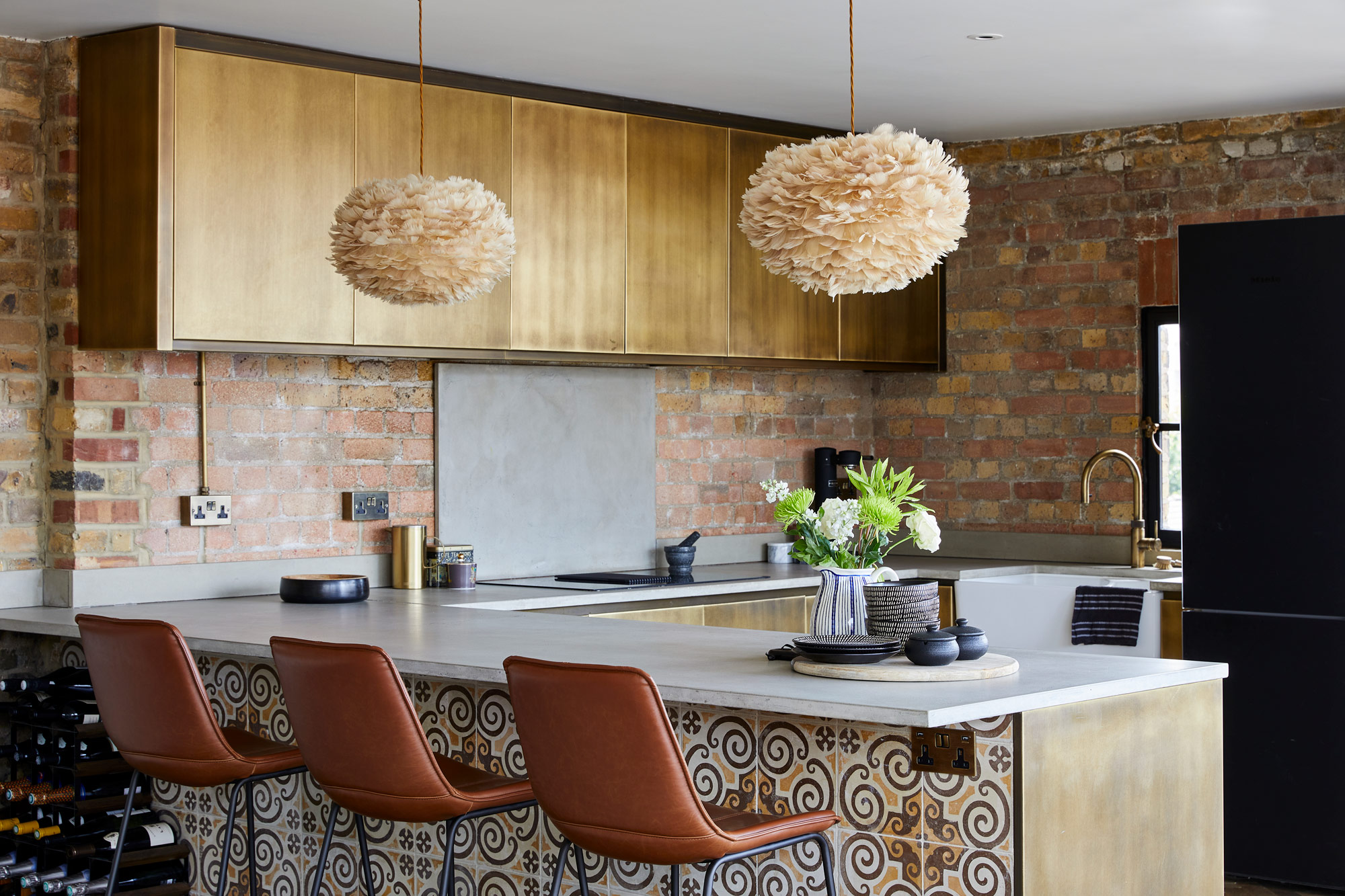 Brass metal kitchen with tiled peninsular