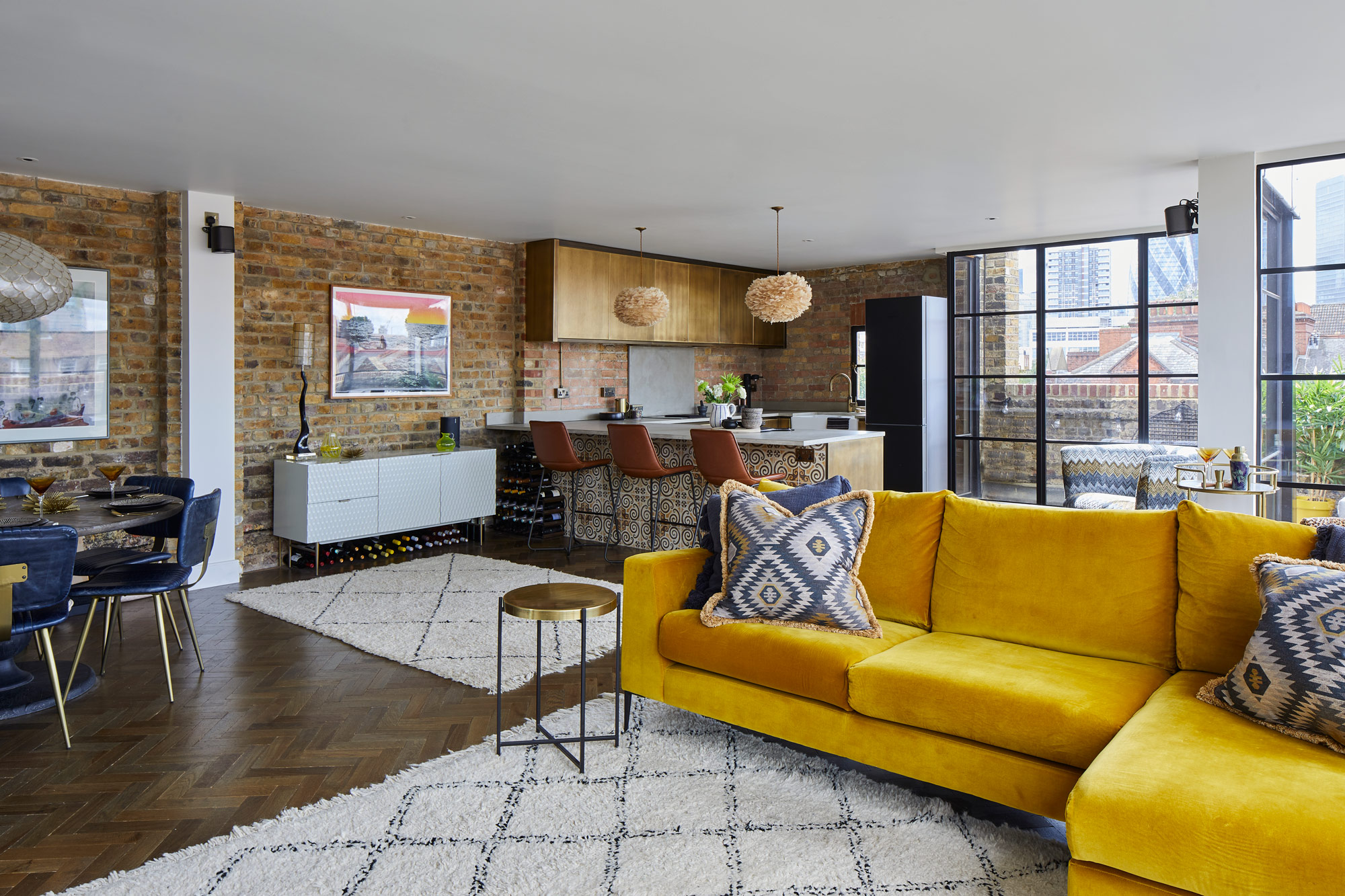 Bright yellow sofa in open plan living space