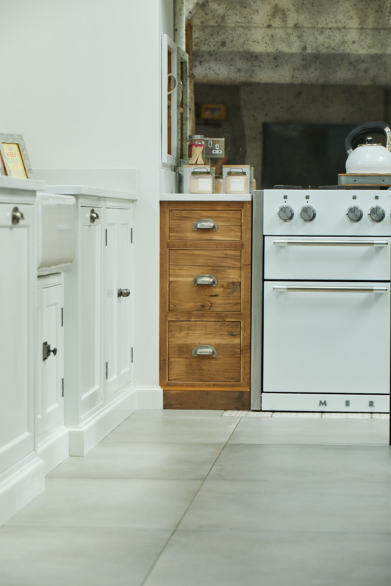 Reclaimed rustic pan drawers next to white Mercury range cooker