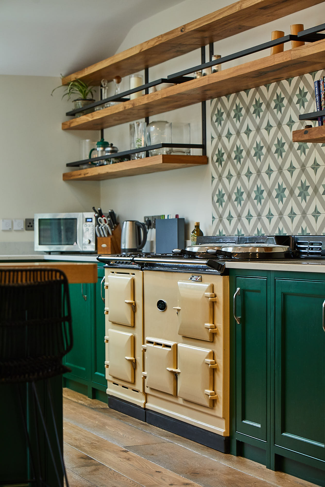 Cream AGA in bespoke kitchen with green shaker cabinets painted in Little Greene paint