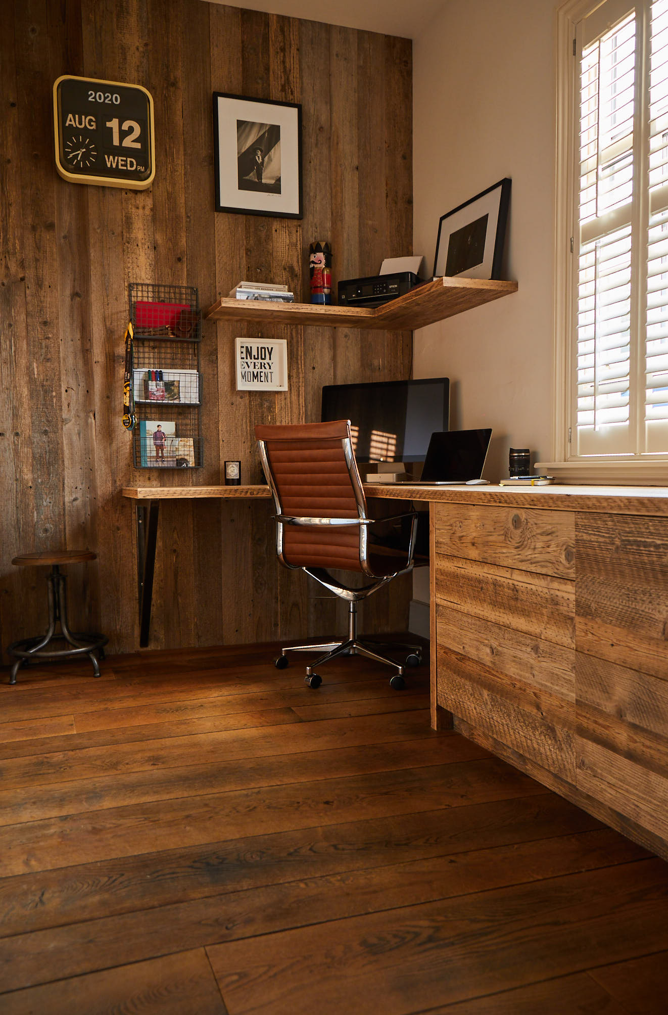 Home office with reclaimed cladding and industrial chair
