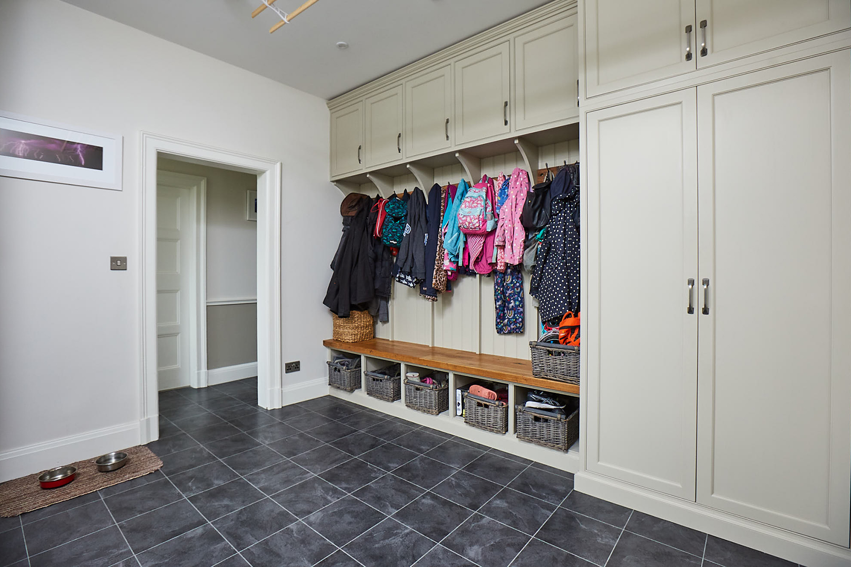 Fitted coat rack with storage lockers painted in Little Greene