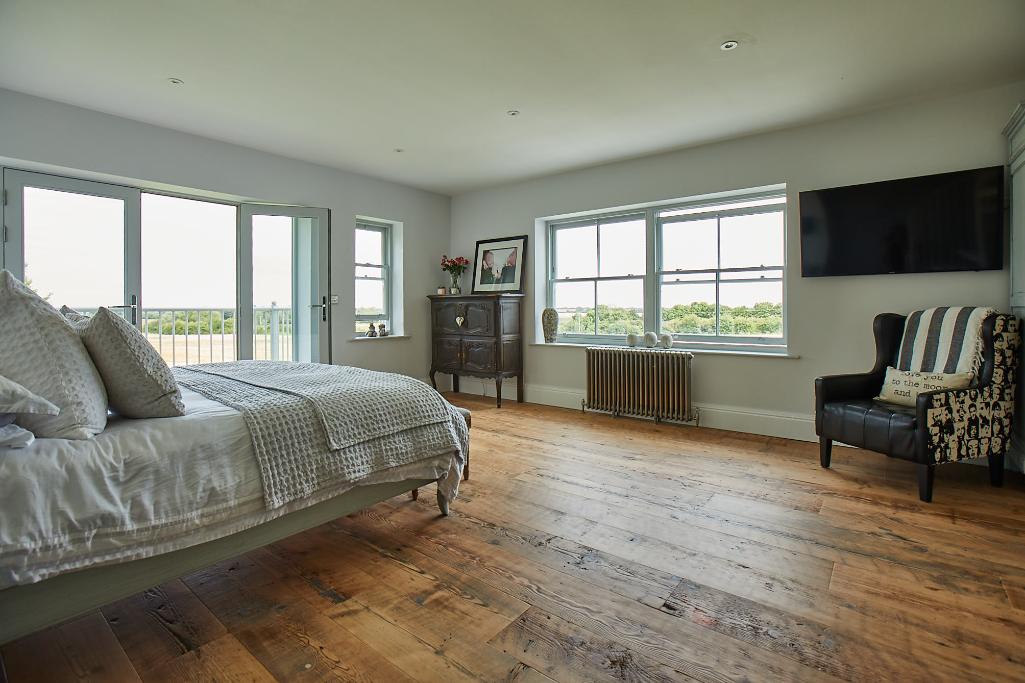 Rustic flooring in bedroom with original pieces of furniture