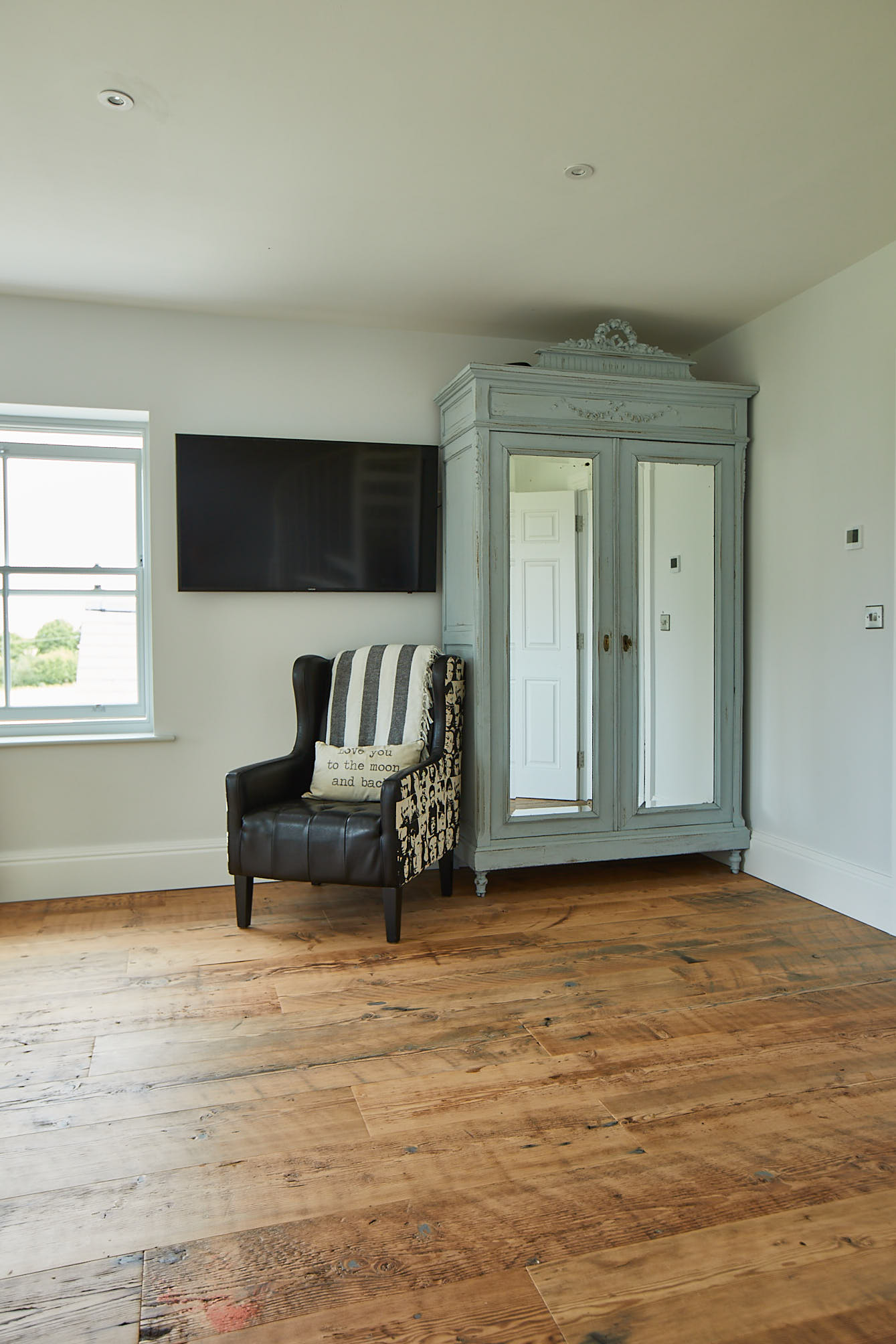 Original blue wardrobe sits on rustic flooring