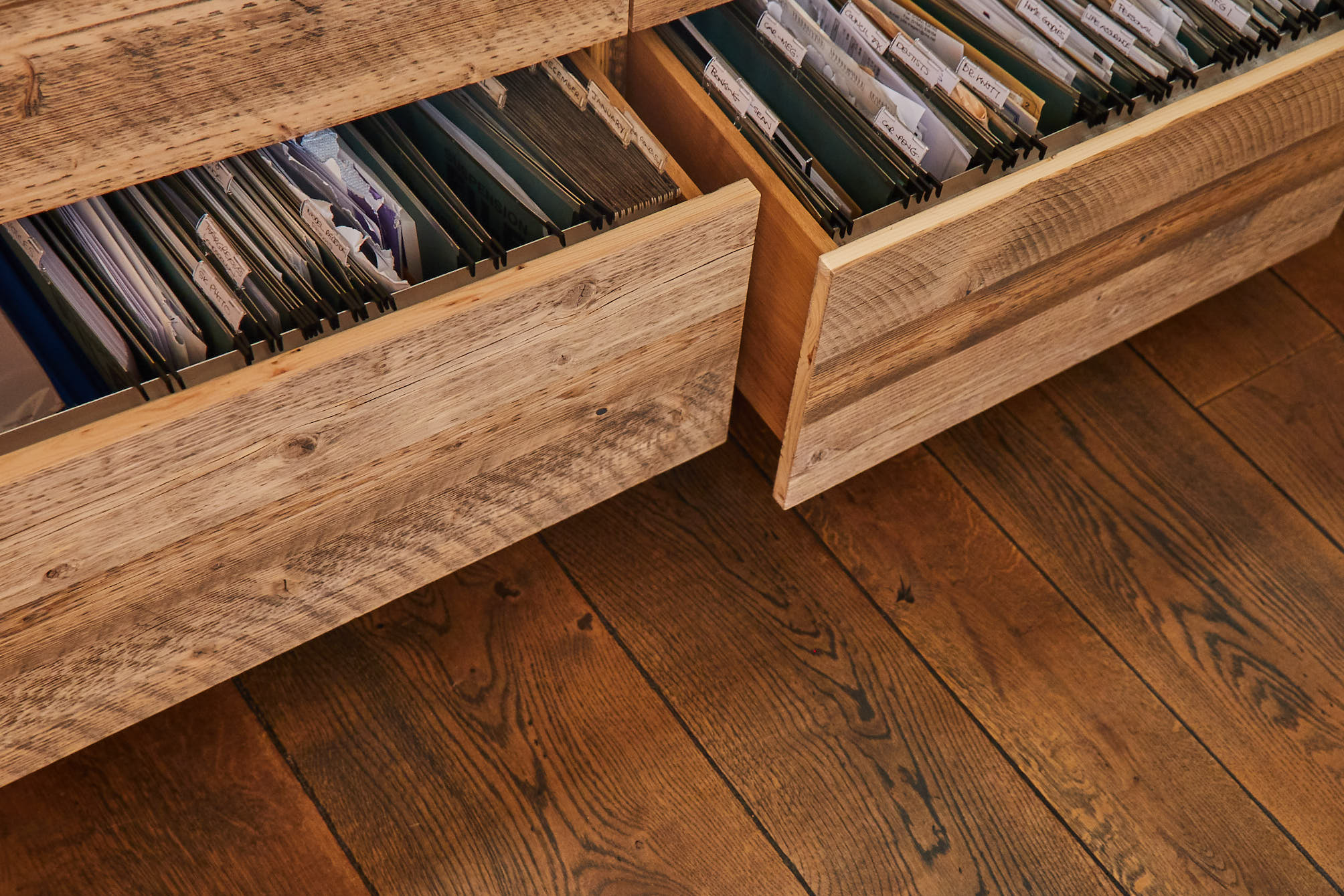 Rustic pine filing cabinets open