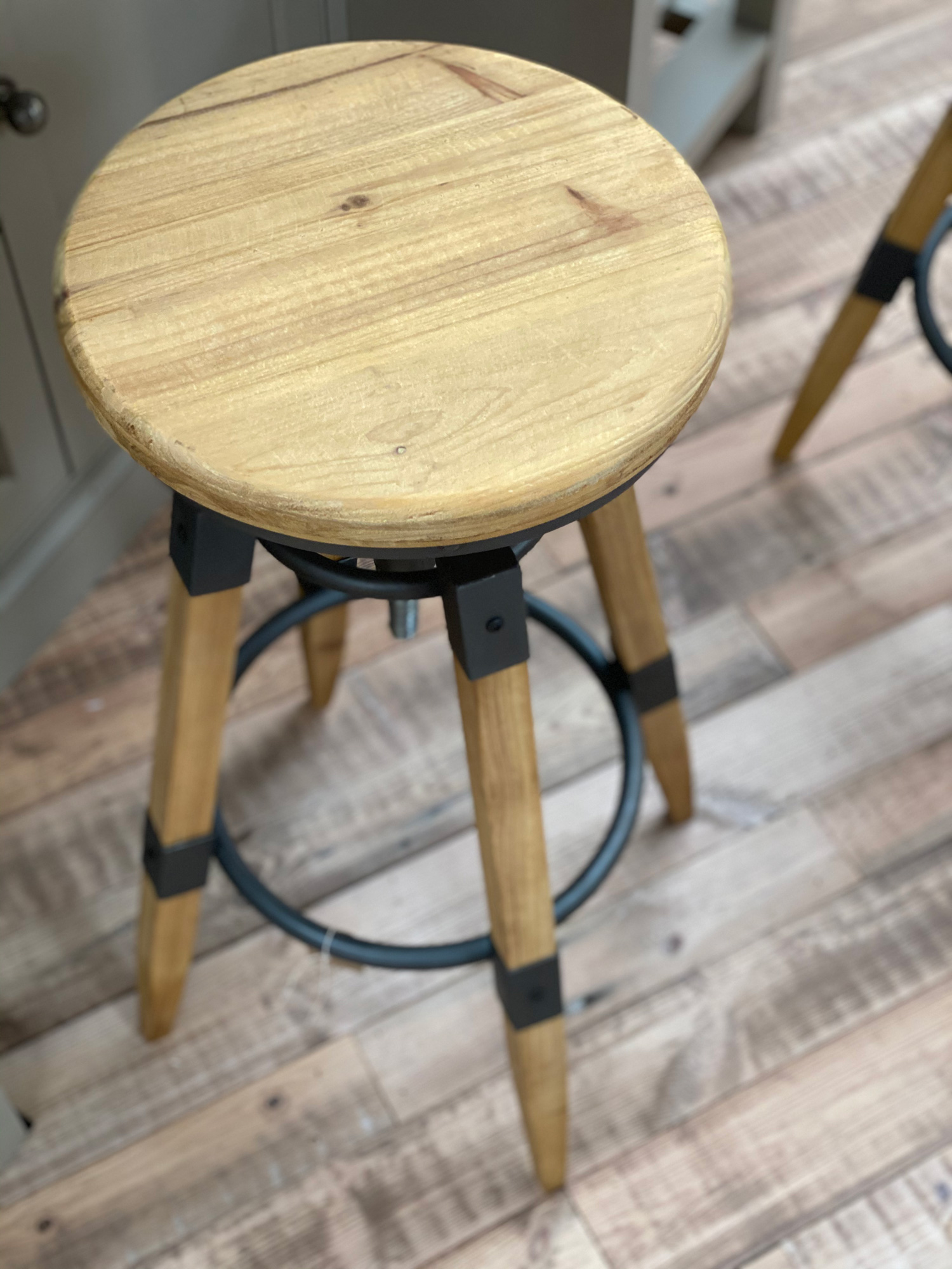 Wood seat on industrial barstool