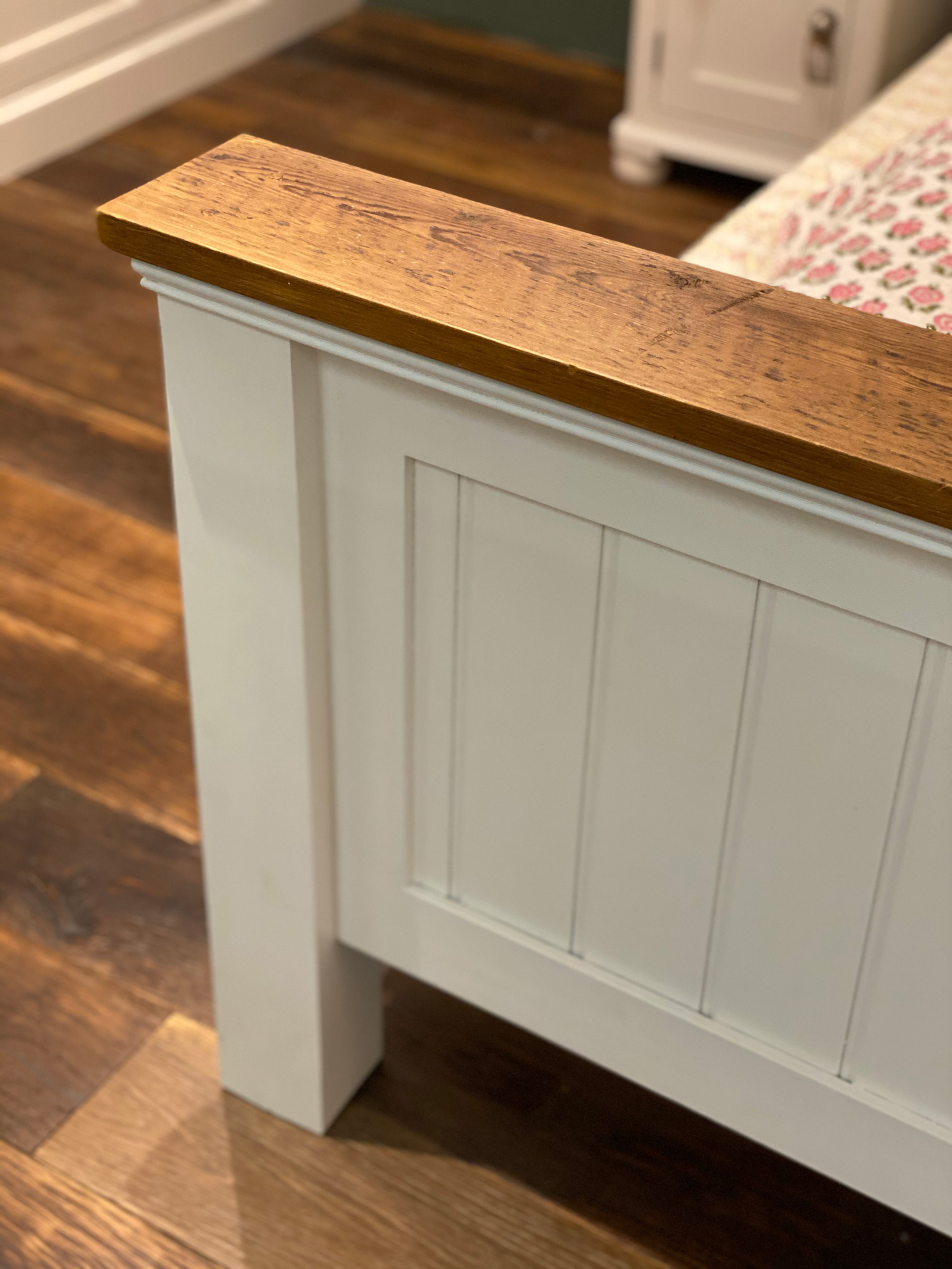 Painted footboard with rustic wood cappping