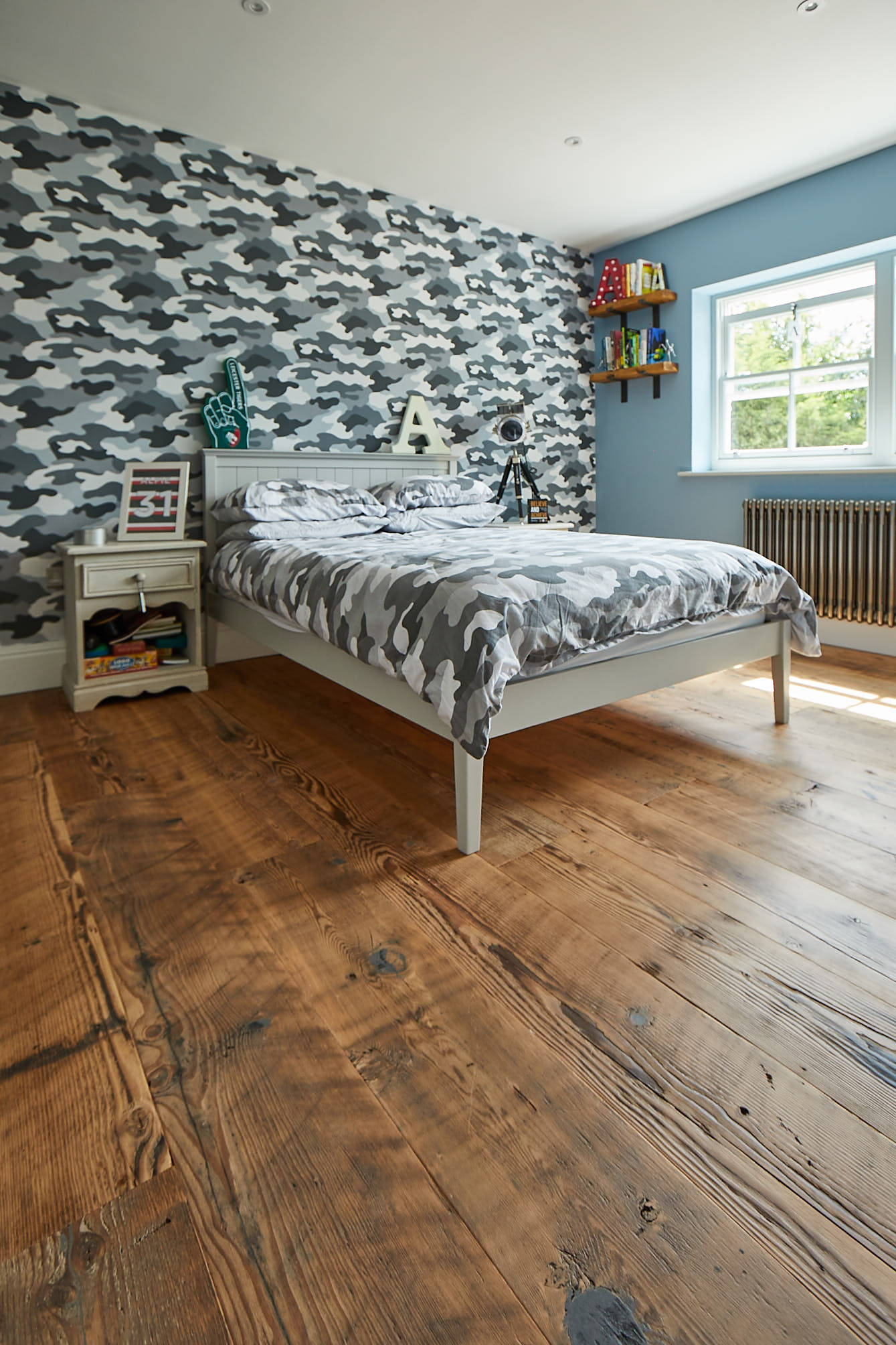 Rustic flooring with camouflage wallpaper