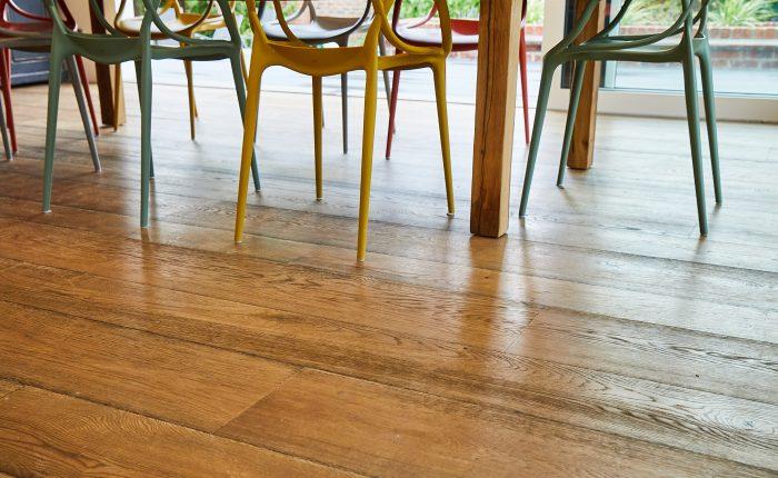 Rustic oak flooring in dining area