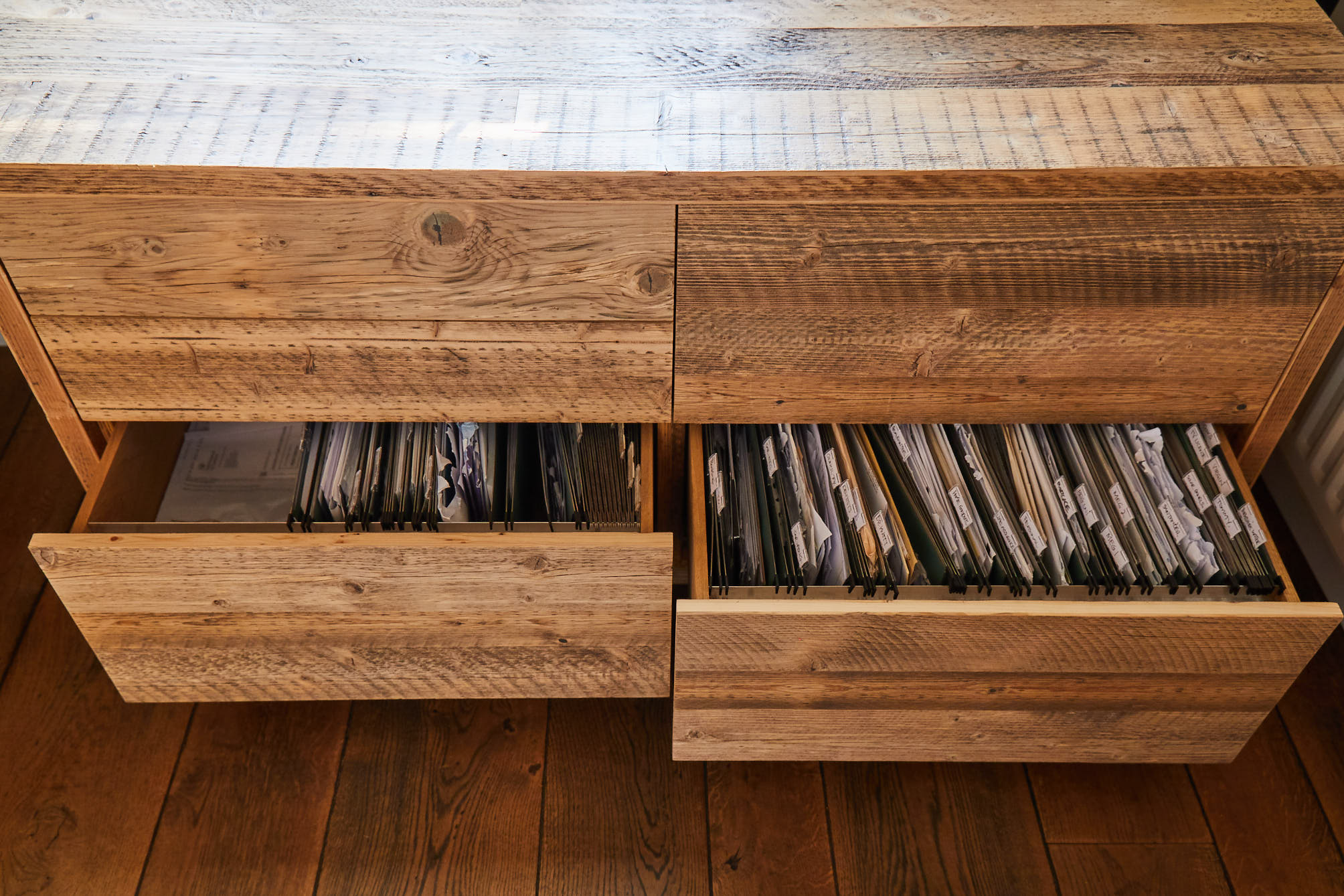 Rustic Filing cabinet drawers open with papers inside