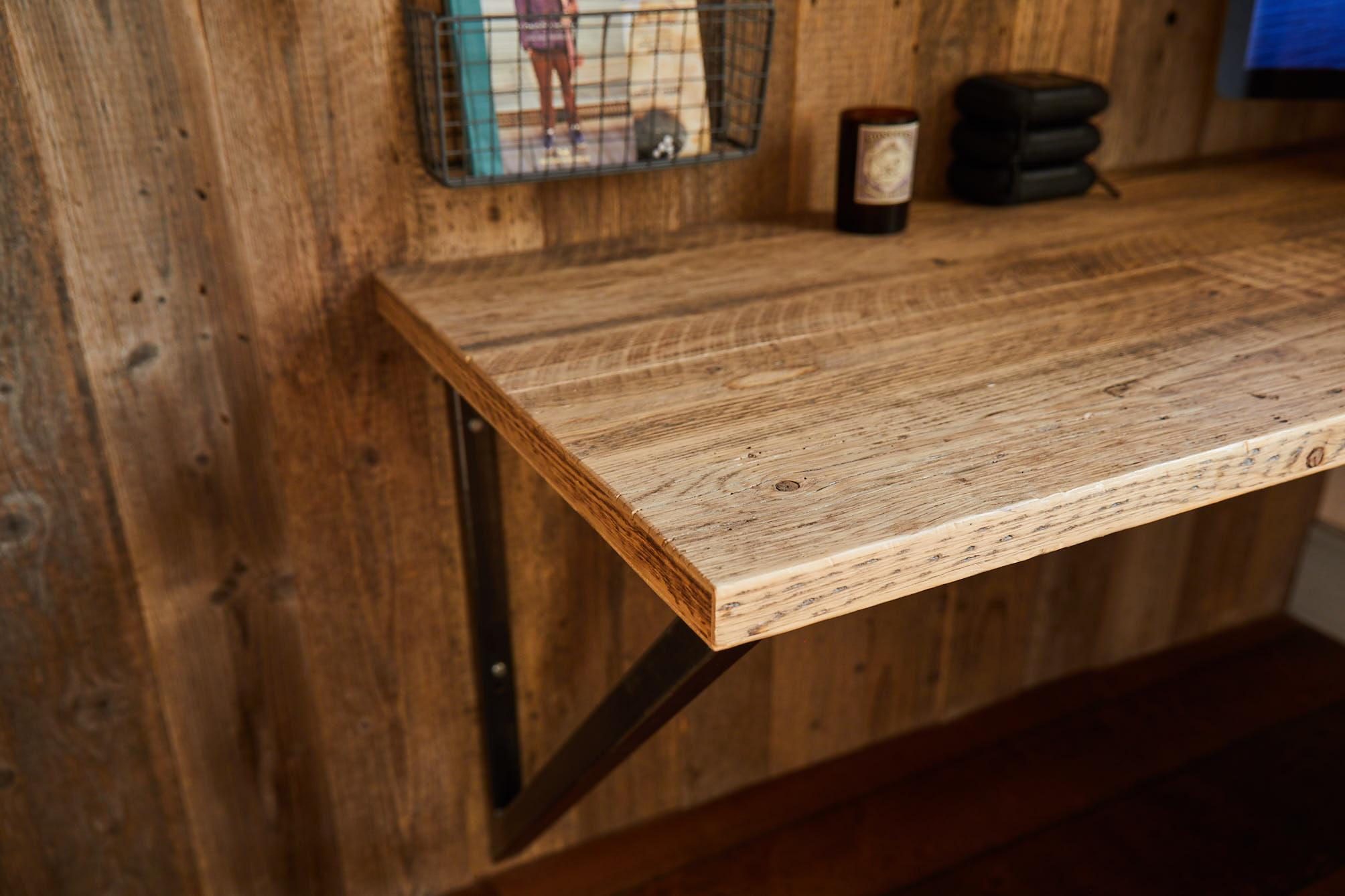 Reclaimed engineered pine shelf with iron bracket