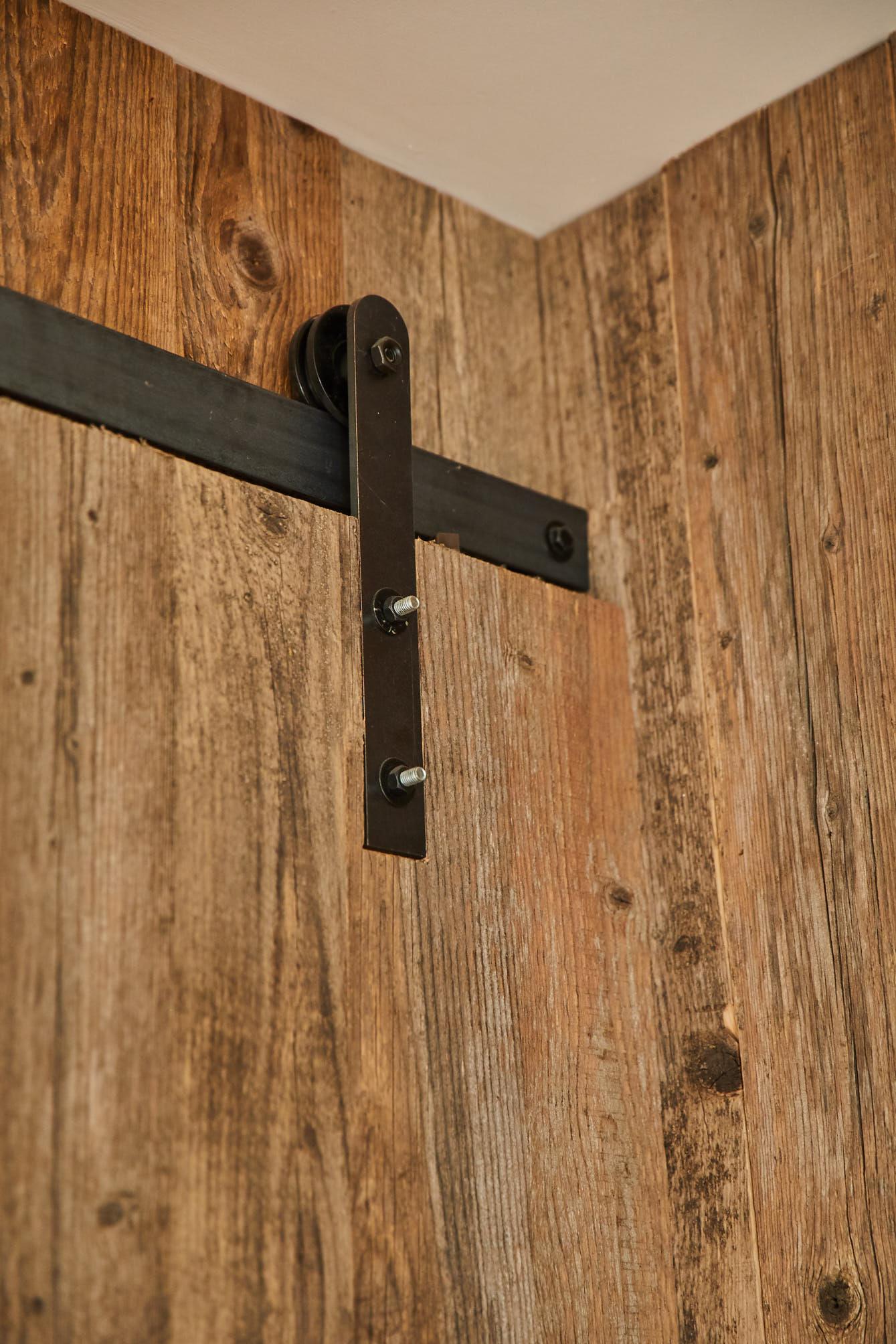 Raw iron sliding door mechanism