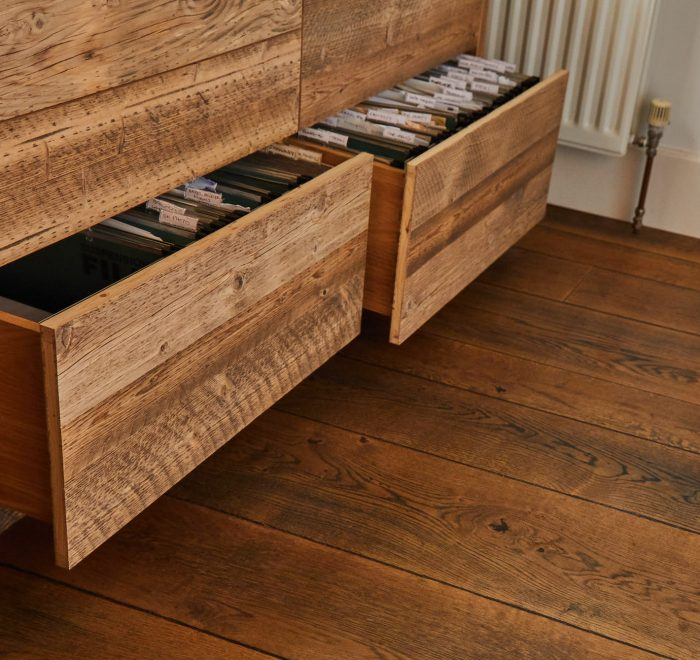 Reclaimed office drawers open with papers inside